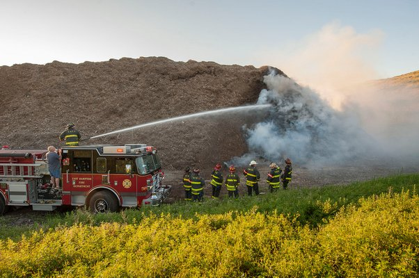 Firefighters respond to a mulch fire in East Hampton early this morning MICHAEL HELLER