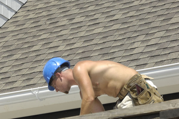 Roofers from EML Construction on the job in Southampton Village on Monday.  DANA SHAW