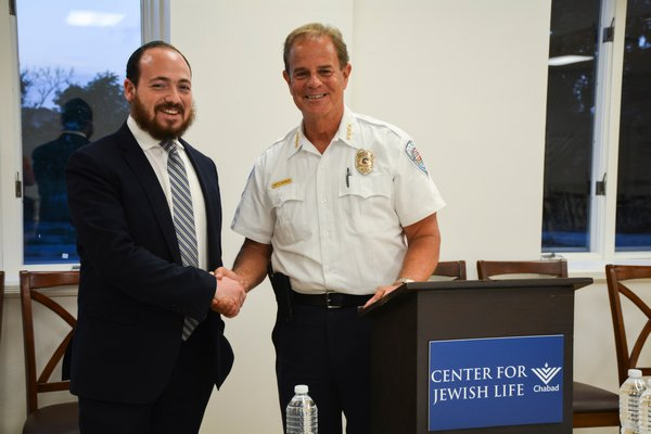 Rabbi Berel Lerman AND  Southampton Town Police Chief Steven Skrynecki at the opioid forum at the Center for Jewish Life - Chabad in Sag Harbor.   DOROTHY MAI