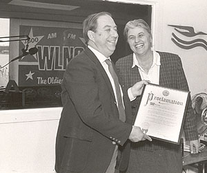 Paul Sidney receives a proclamation in 1989 from Southampton town Supervisor Mardythe DiPirro.