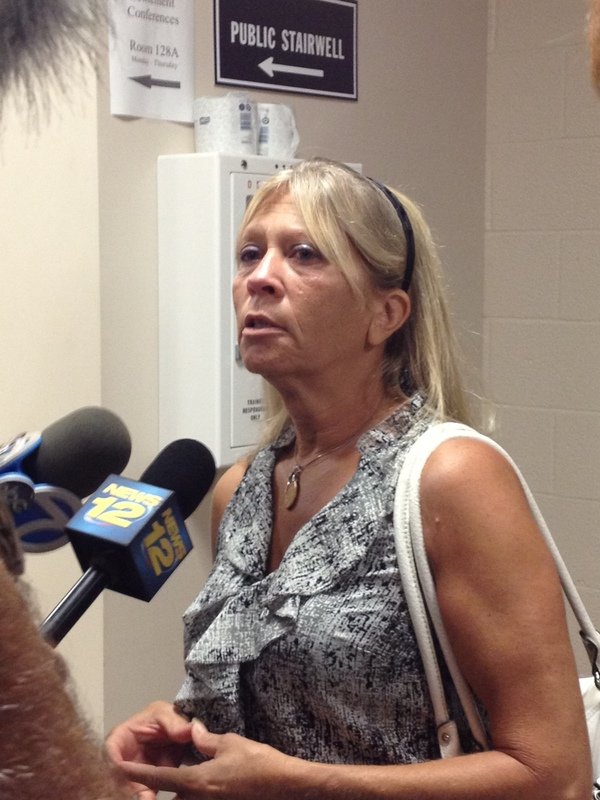 Dorothy Marino speaks to reporters outside the courtroom on Thursday morning after reaching a settlement in a civil suit against the woman who struck and killed her son in 2009. CAROL MORAN