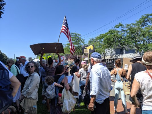 Protesters in Water Mill resisting the president's visit. JENNIFER CORR