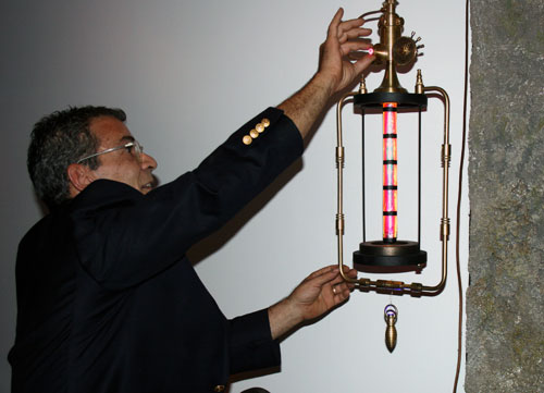 Art Donovan demonstrates the dimmer function on one of his steampunk lights.