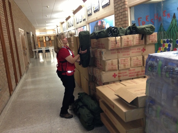 Red Cross Shelter Manager Sherry Wheaton with some of the cots at the Red Cross Emergency Shelter at Hampton Bays High School on Sunday morning. DANA SHAW