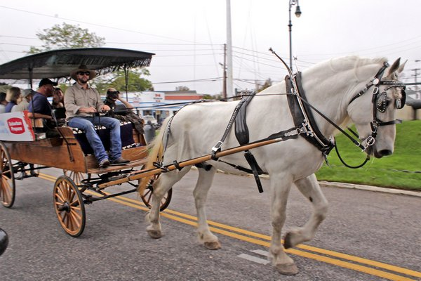 A horse and buggy ride through Southampton Village during the 2017 SouthamptonFest. PRESS FILE.