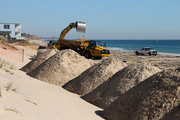 Many are angered by the construction that began this week on a stretch of Montauk shoreline. The Downtown Montauk Emergency Stabilization Project will result in a revetment of large sandbags covering the beach. KYRIL BROMLEY