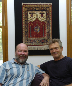 Ken Dorph and Stuart Lowrie in their Sag Harbor home. Behind them is a Turkish Prayer Rug.