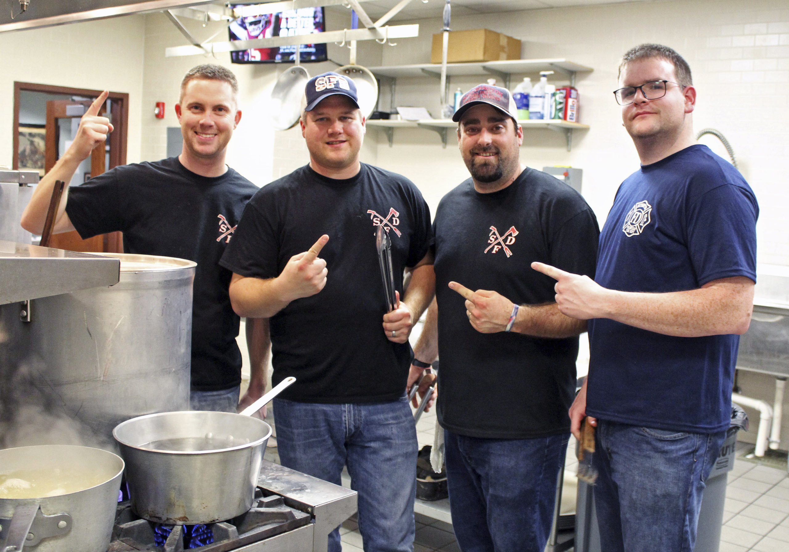 Chefs in the kitchen at the spaghetti dinner to benefit the Southampton Fire Department Hockey Team on Saturday are: Lieutenant Jeremy McMahon, Captain Rick Fowler, Lt. James Duryea and Steve Iecensoha.   TOM KOCHIE