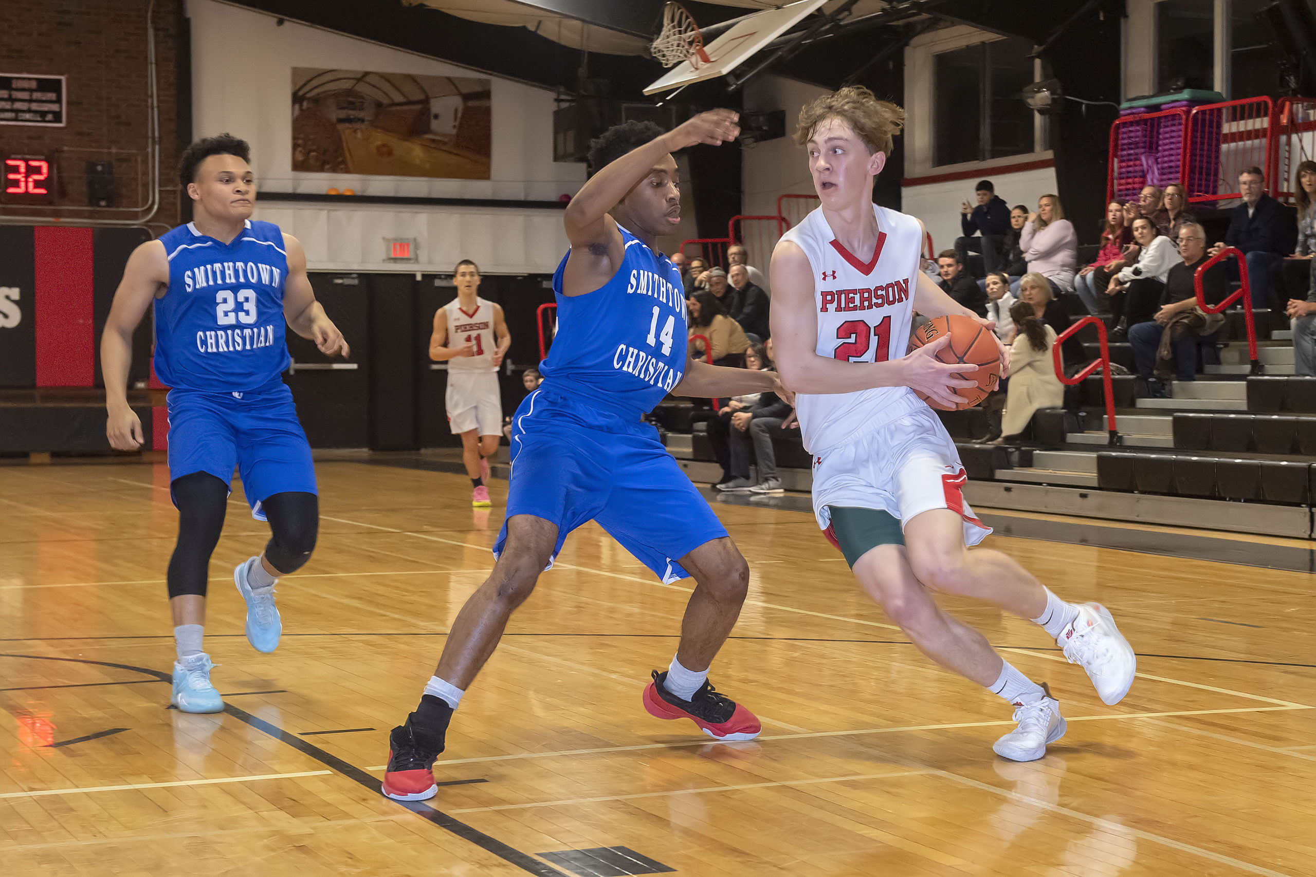 Pierson's Wilson Bennett drives to the basket against a Smithtown Christian defender on Monday night.