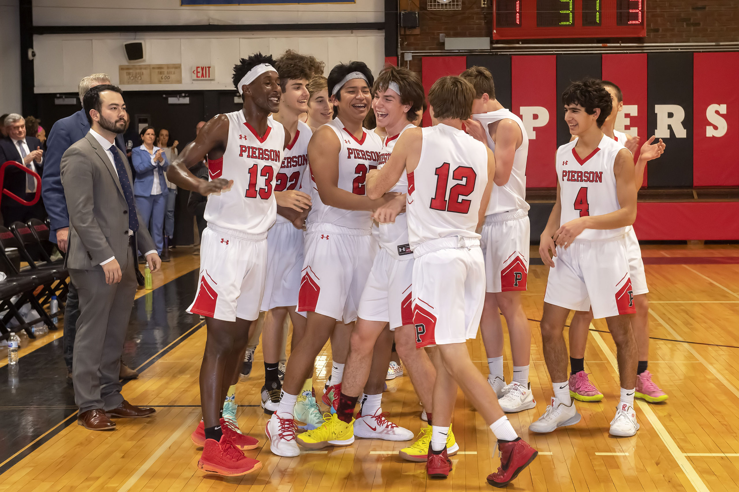 Pierson's Henry Brooks is mobbed by his teammates after making his 1,000th career point.