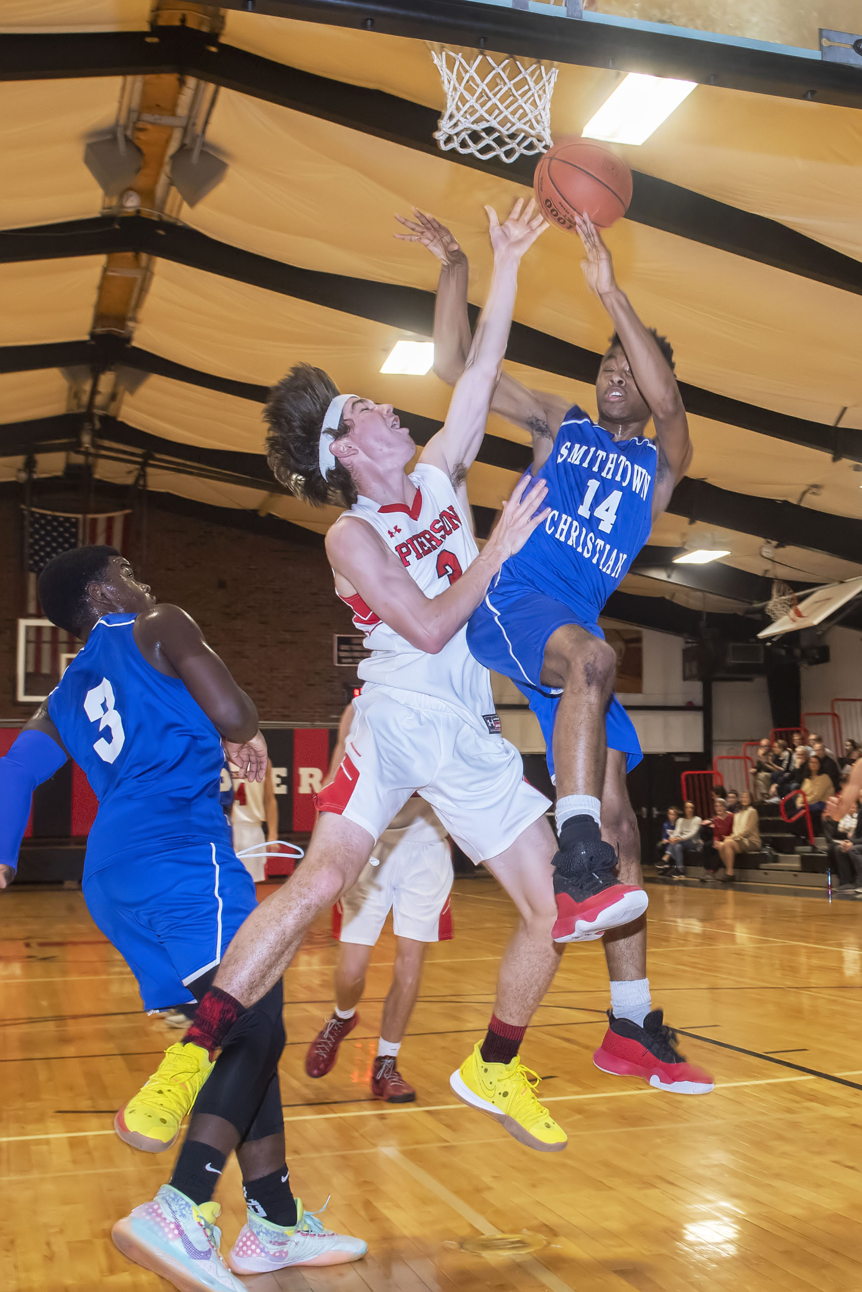Pierson's Henry Brooks goes up with a Smithtown Christian player for the ball.