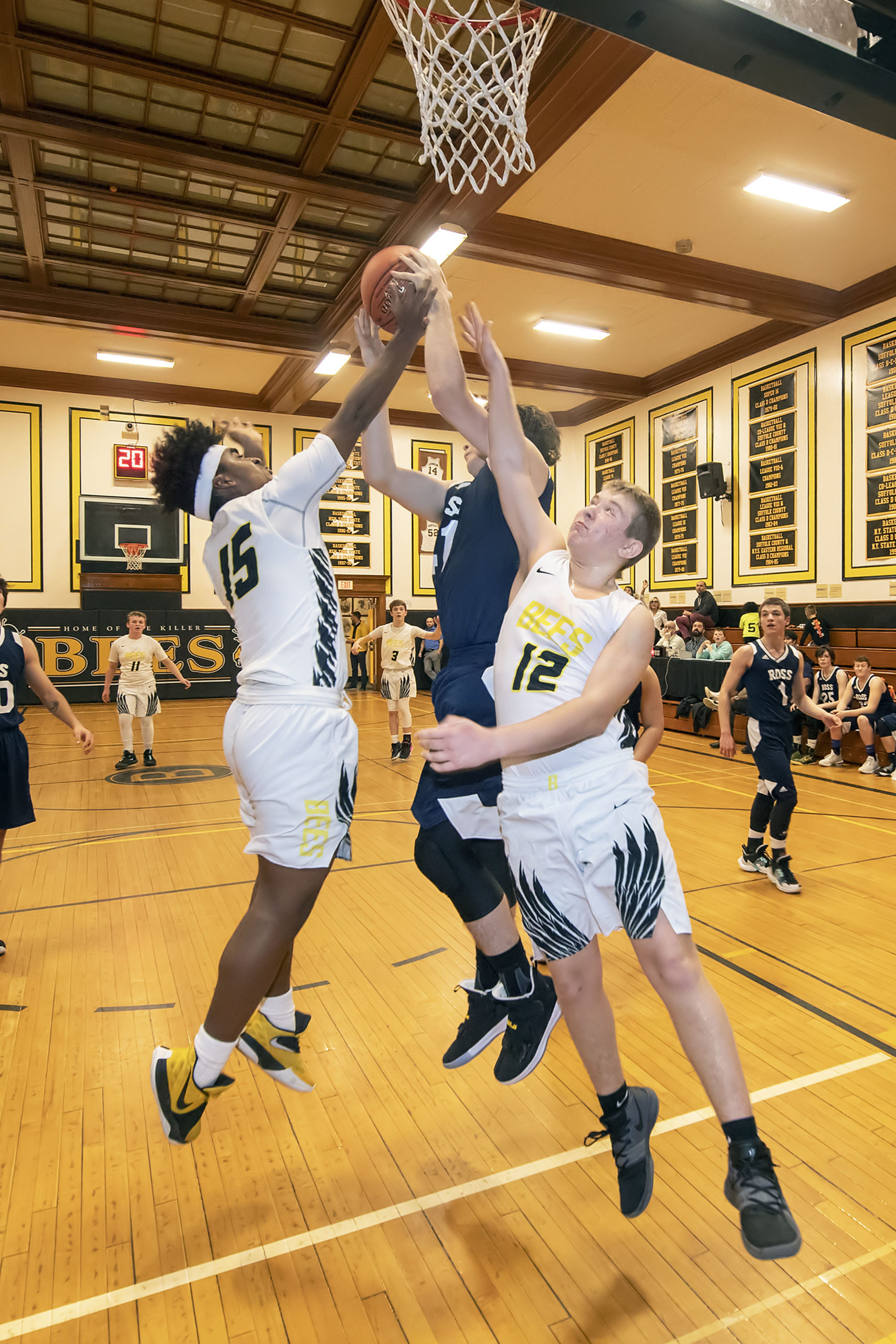 Bridgehampton's David Simms and Jack Boeshore fight for a rebound.