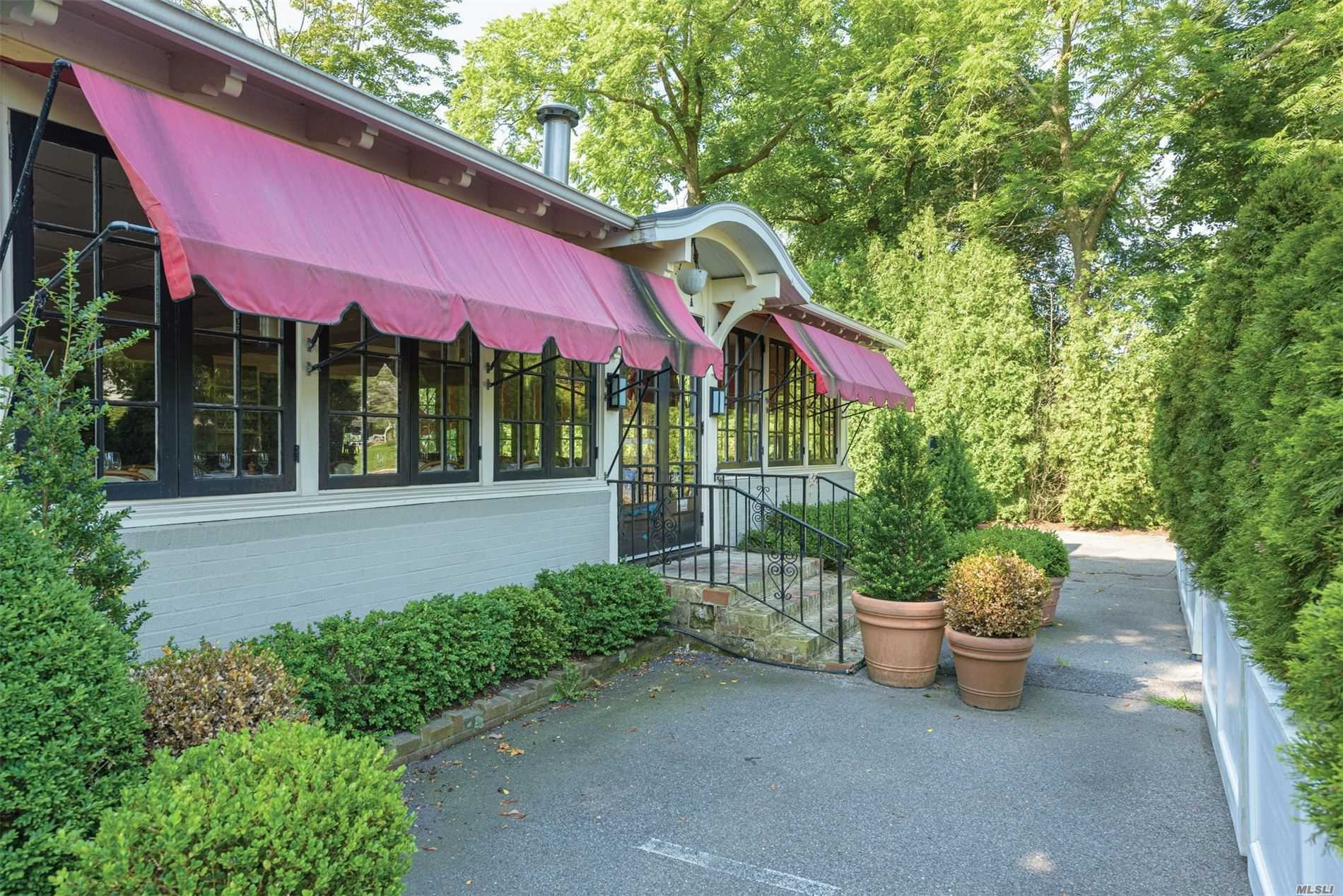 The site of shuttered restaurant Red Bar, 210 Hampton Road in Southampton Village, is for sale. COURTESY DOUGLAS ELLIMAN