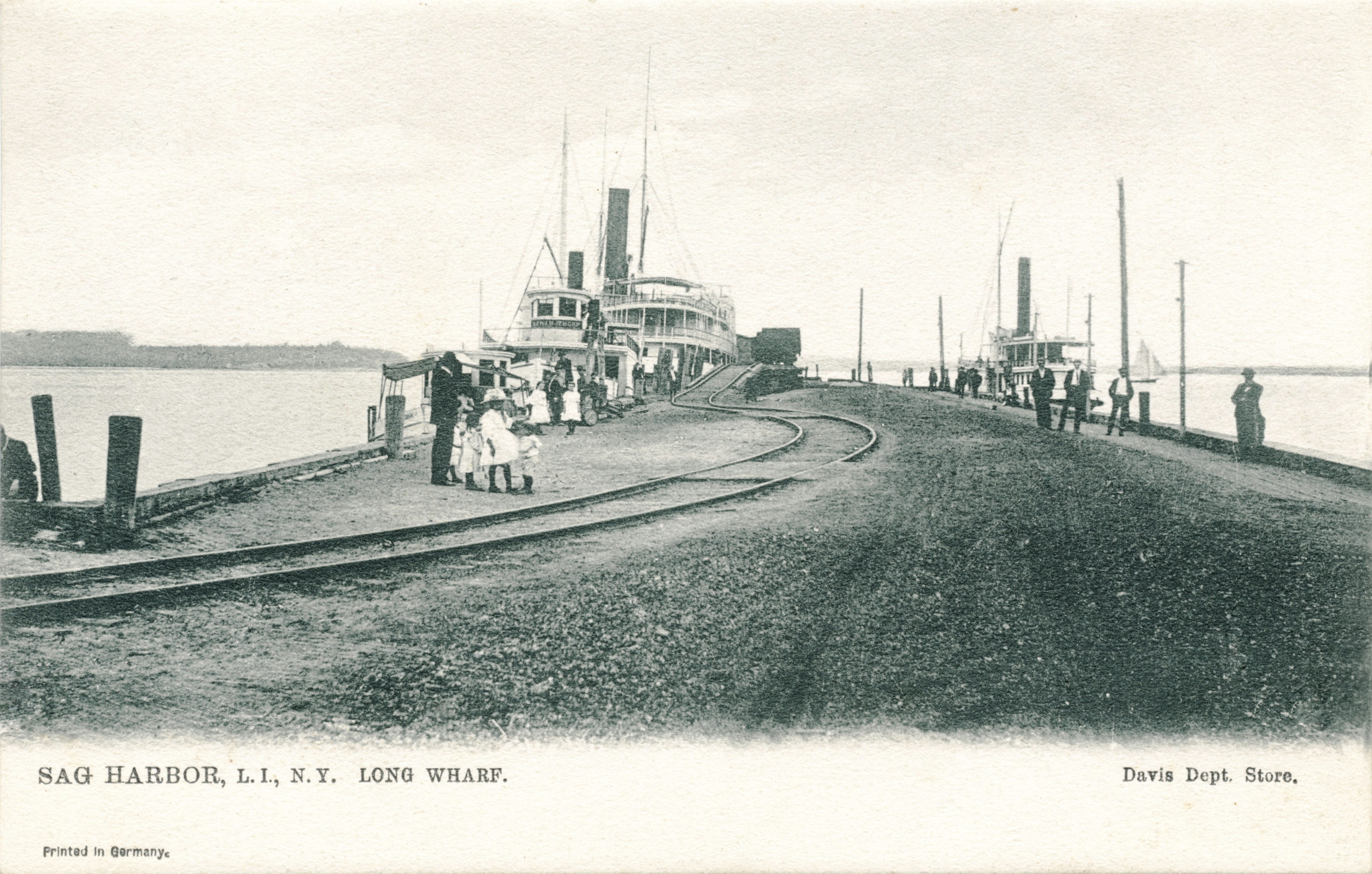 A postcard, circa 1910, shows the railway going onto Long Wharf at just about the same spot where the rail section was found by workers excavating.