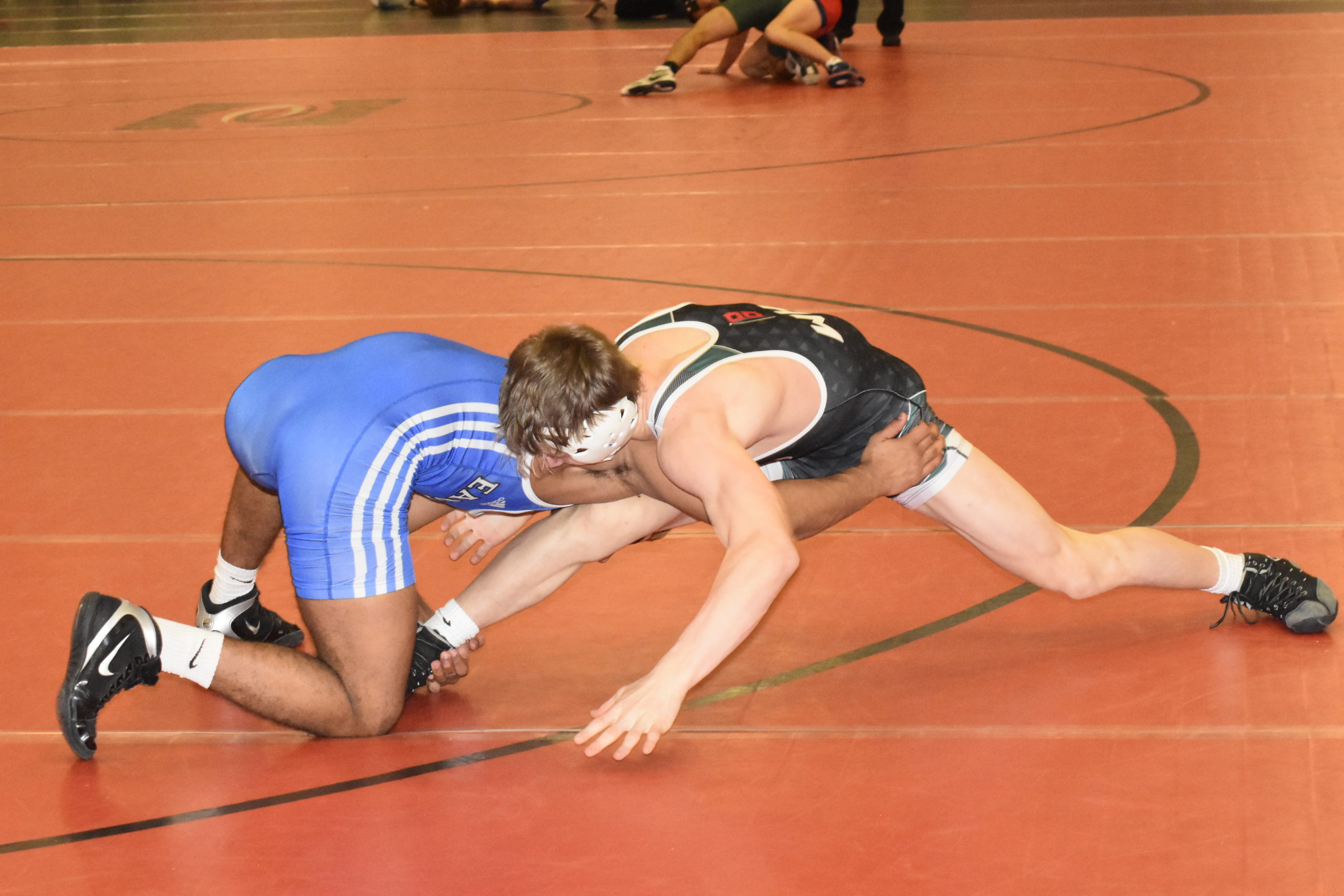 Gavin McIntyre tries to defend against his Copiague opponent.