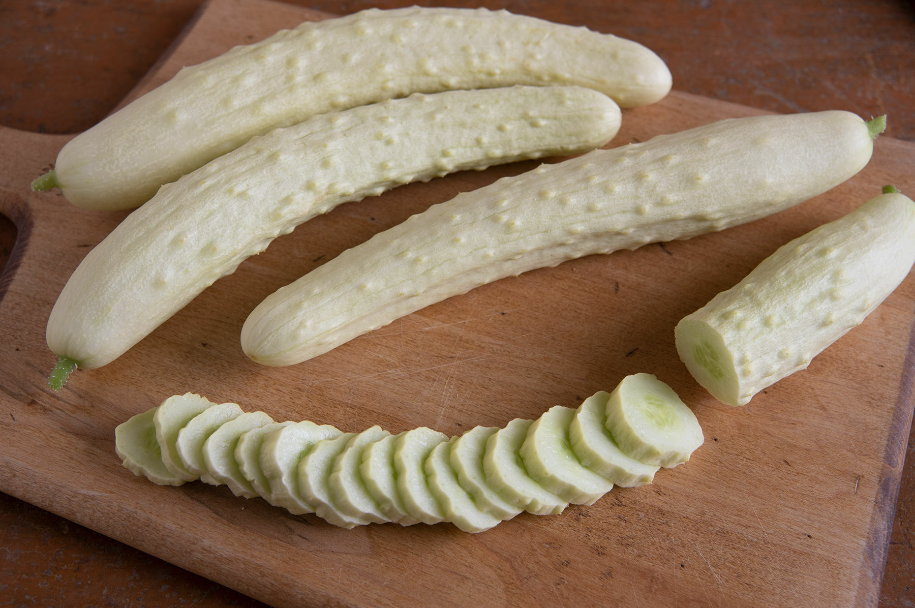 Most gardeners are not familiar with the white varieties. Like this Itachi from Johnny's they tend to be mild to sweet with few to no seeds. This is a cuke that is 9 to 11 inches long, an Asian type, and it needs to be grown vertically. From seeding to harvest in warm soil, about 55 days. COURTESY NBG