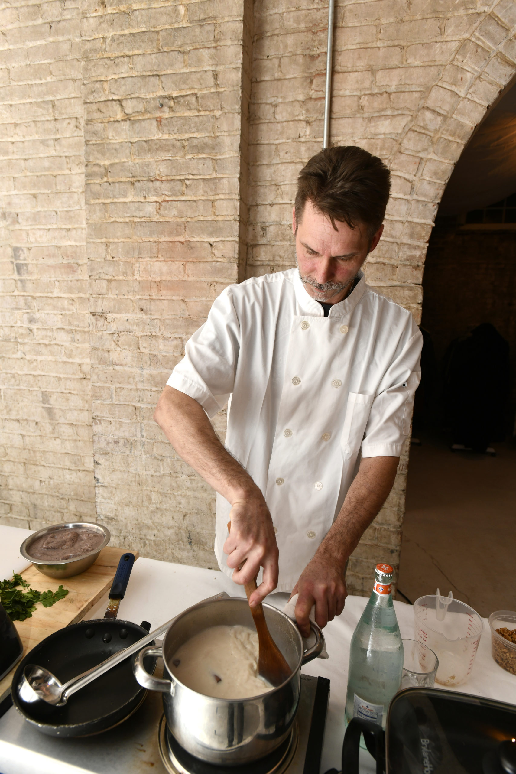 Chef Jon Albrecht prepares a dish at a class at The Spur in Southampton.