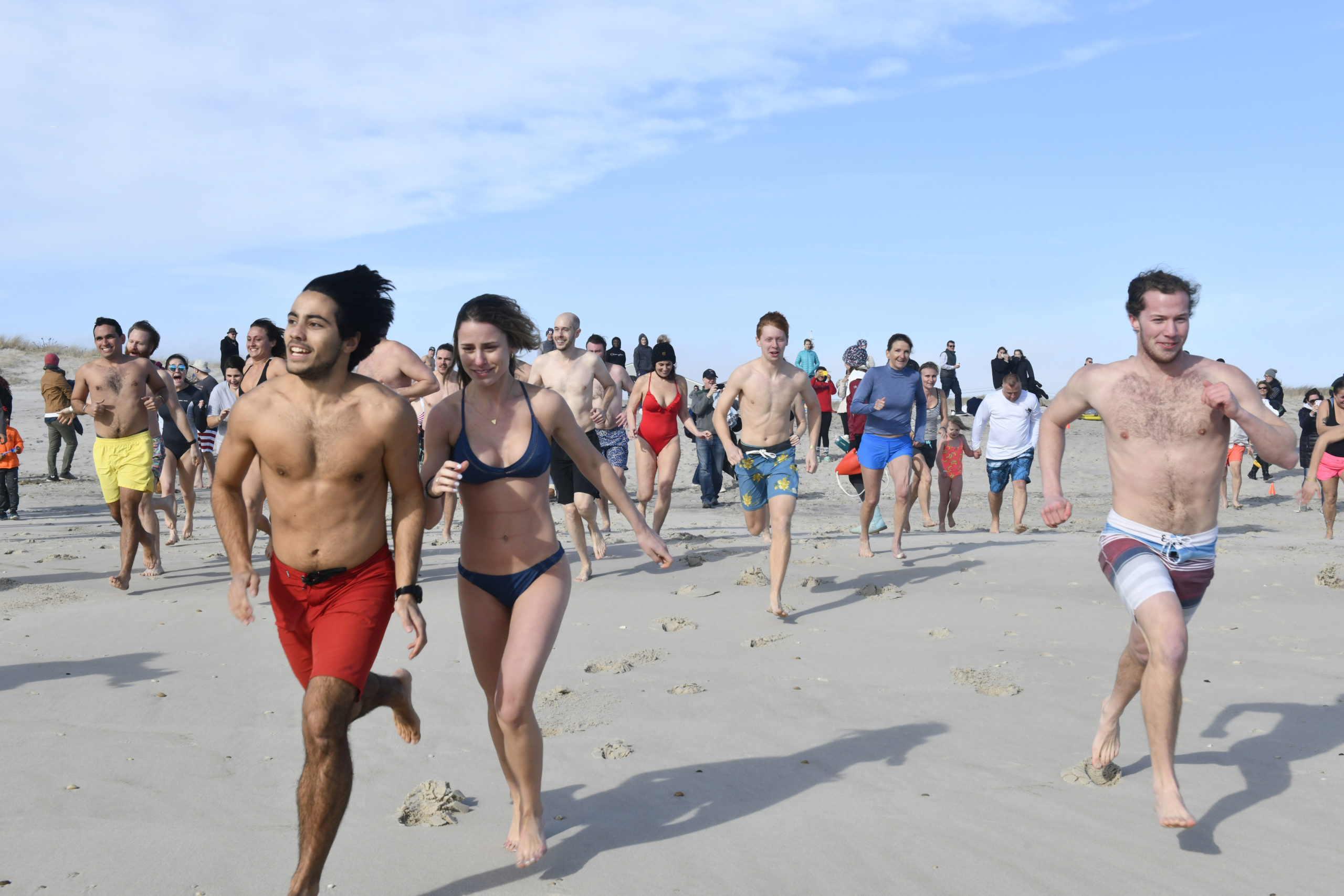 Plungers head into the water on Saturday afternoon at Rogers Beach.