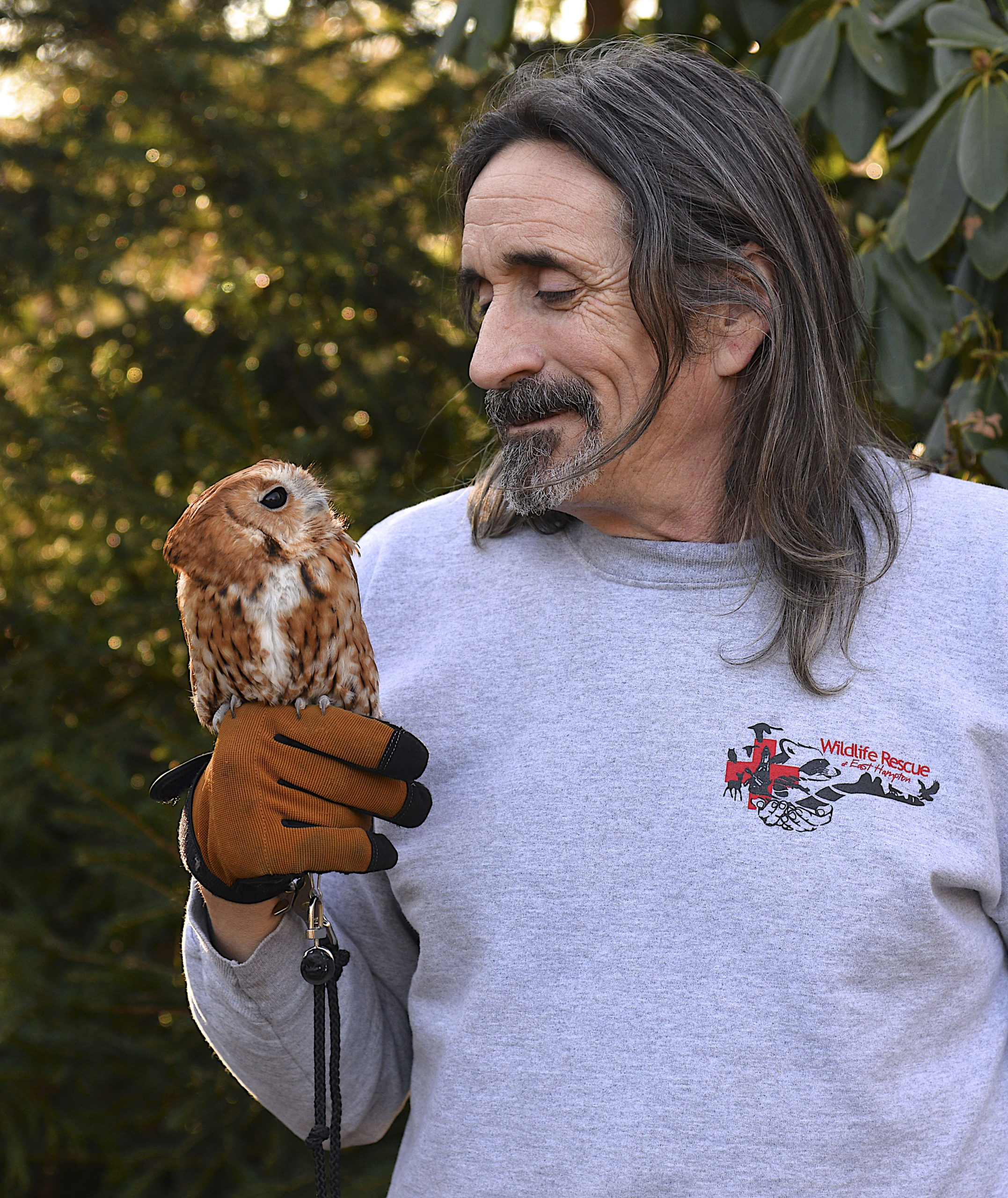 Dell Cullum with blind eastern screech owl Athena.  KYRIL BROMLEY