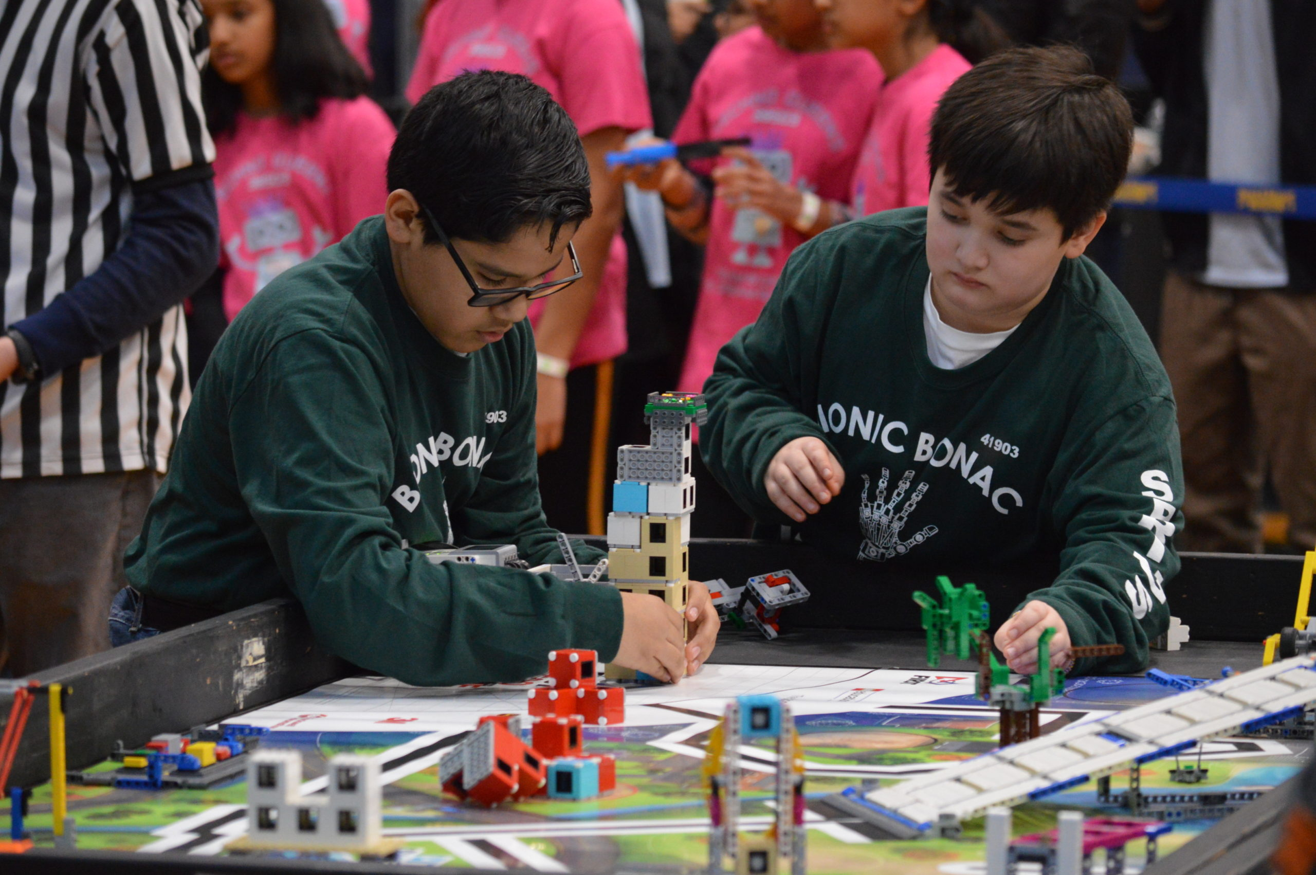 """Three teams from Springs School — the Springin' Ospreys, the Springs School Robonackers and the Bionic Bonac Builders — competed Saturday at Huntington High School in one of seven qualifier rounds of the Long Island FIRST LEGO League Tournament season. While none of the teams, comprising students in fifth, sixth and seventh grades, advanced to the Long Island final, the teams all placed in the top 10 of the robotics competition. Marcos Munoz, left, and Thomas """"T.K."""" Sookshawee-Barnard at the table for the Bionic Bonac Builders. GAVIN MENU PHOTOS"""