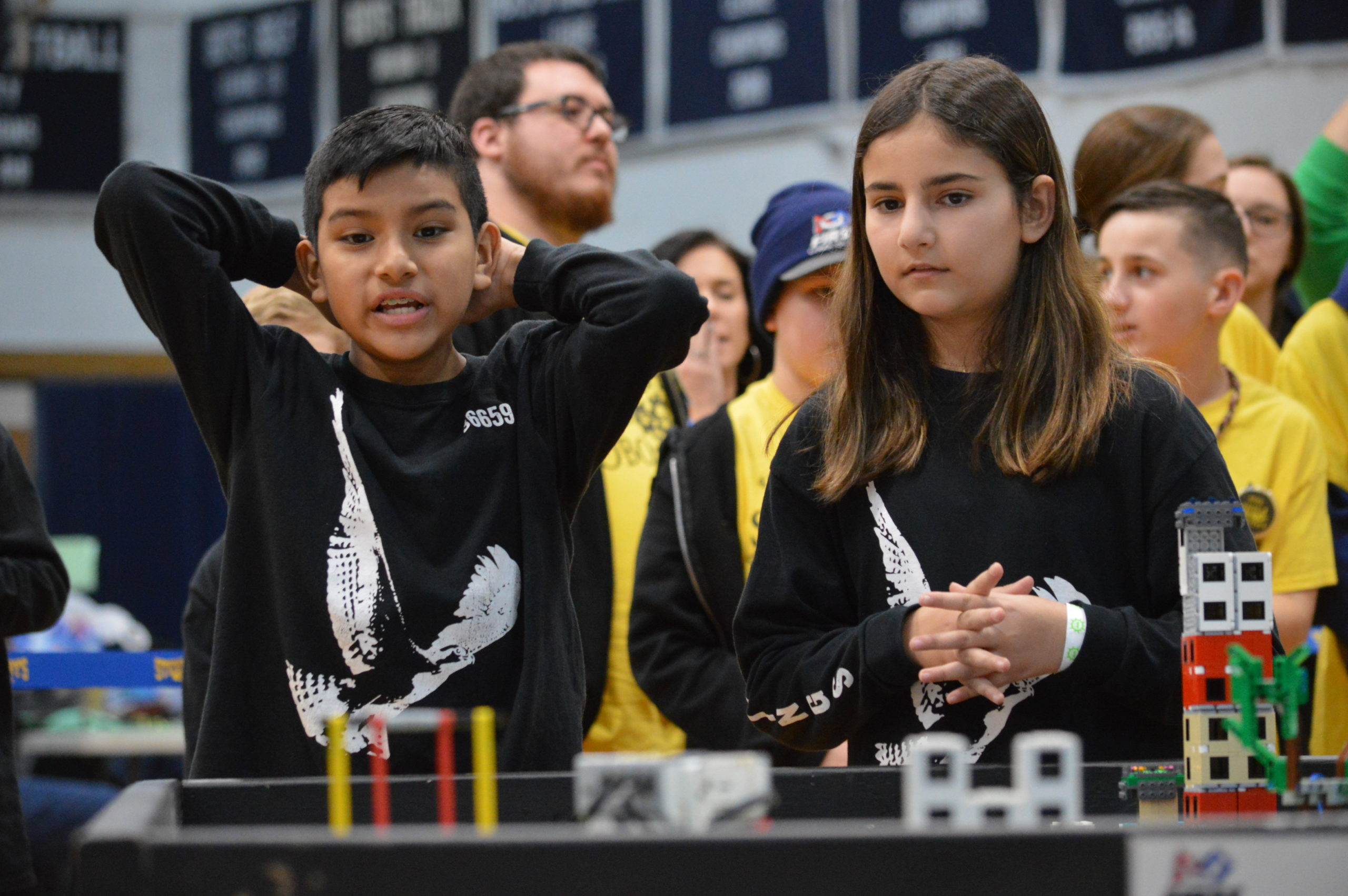 Three teams from Springs School — the Springin' Ospreys, the Springs School Robonkacers and the Bionic Bonac Builders — competed Saturday at Huntington High School in one of seven qualifier rounds of the Long Island FIRST LEGO League Tournament season. While none of the teams, comprising students in fifth, sixth and seventh grades, advanced to the Long Island final, the teams all placed in the top 10 of the robotics competition. Ariel Puin Mayancela, left, and Shanli Yaghoubi compete for the Springin' Ospreys at Huntington High School on Saturday. GAVIN MENU