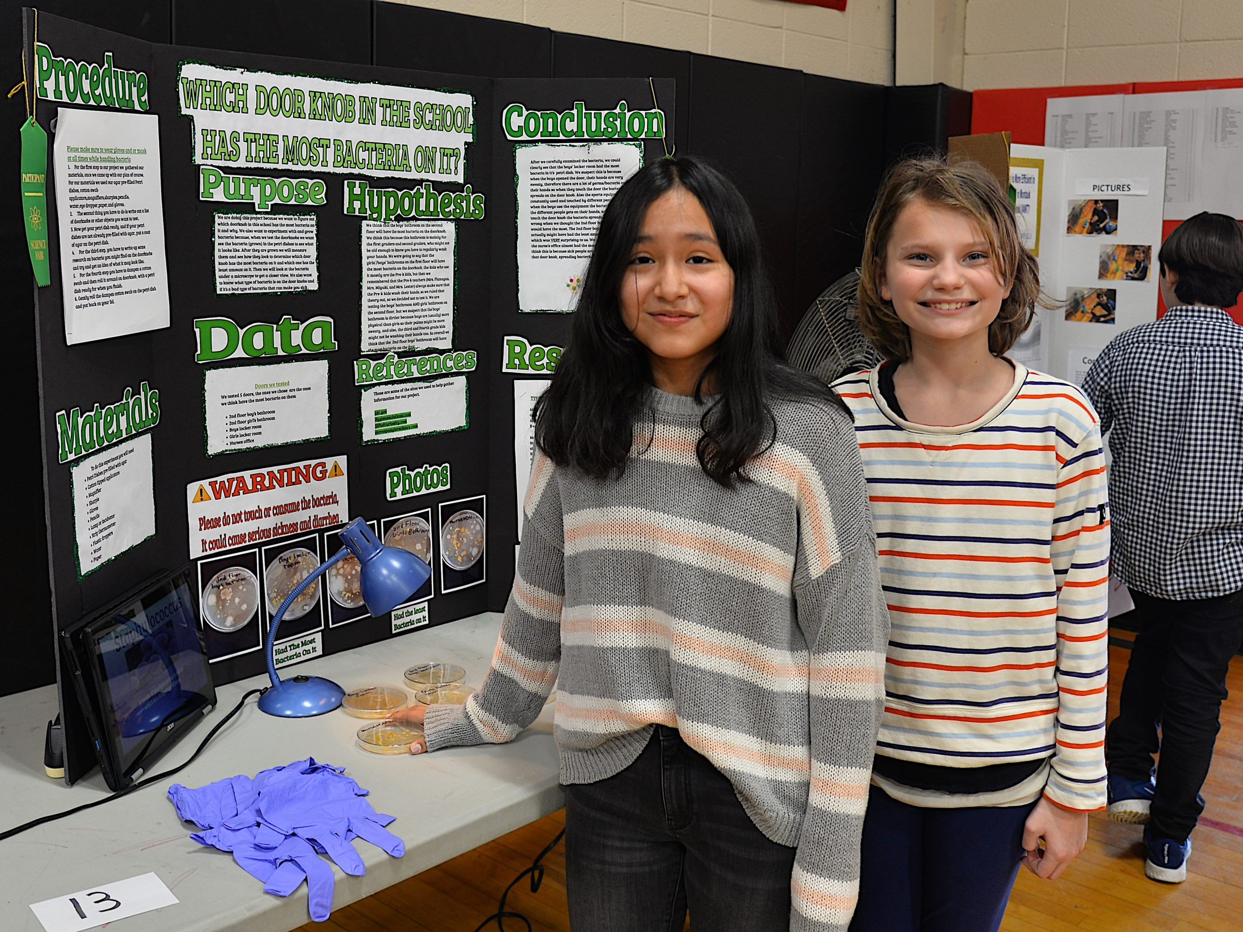 Montauk School and the Concerned Citizens of Montauk partnered for the annual Montauk School Science Fair on Friday. Amanda Arias's and Bea Flight's project was to determine which school doorknobs contained the most bacteria. KYRIL BROMLEY