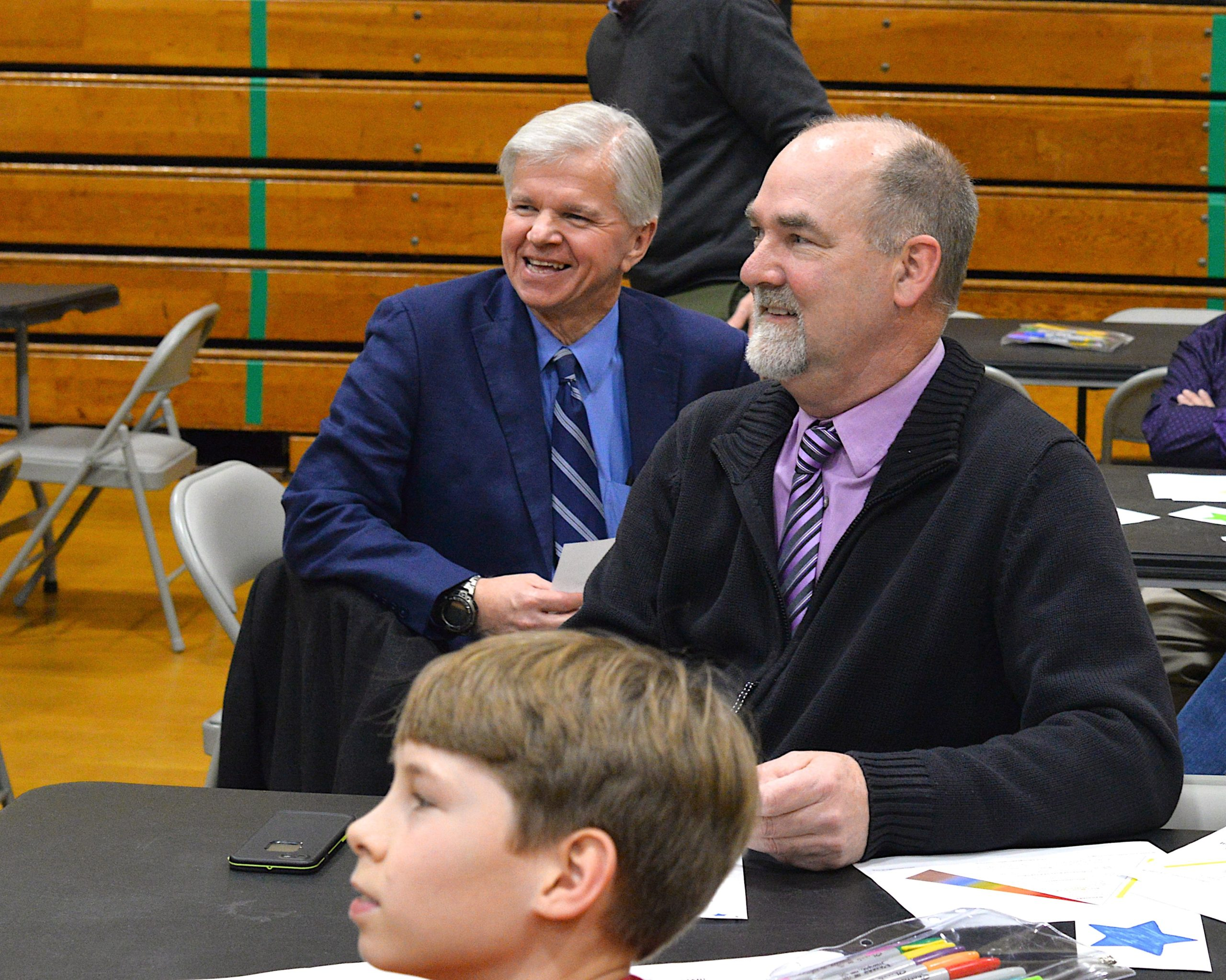 Assemblyman Fred W. Thiele Jr. and East Hampton Town Supervisor Peter Van Scoyoc listen to a presentation at the Springs School Diversity Institute on Friday. KYRIL BROMLEY