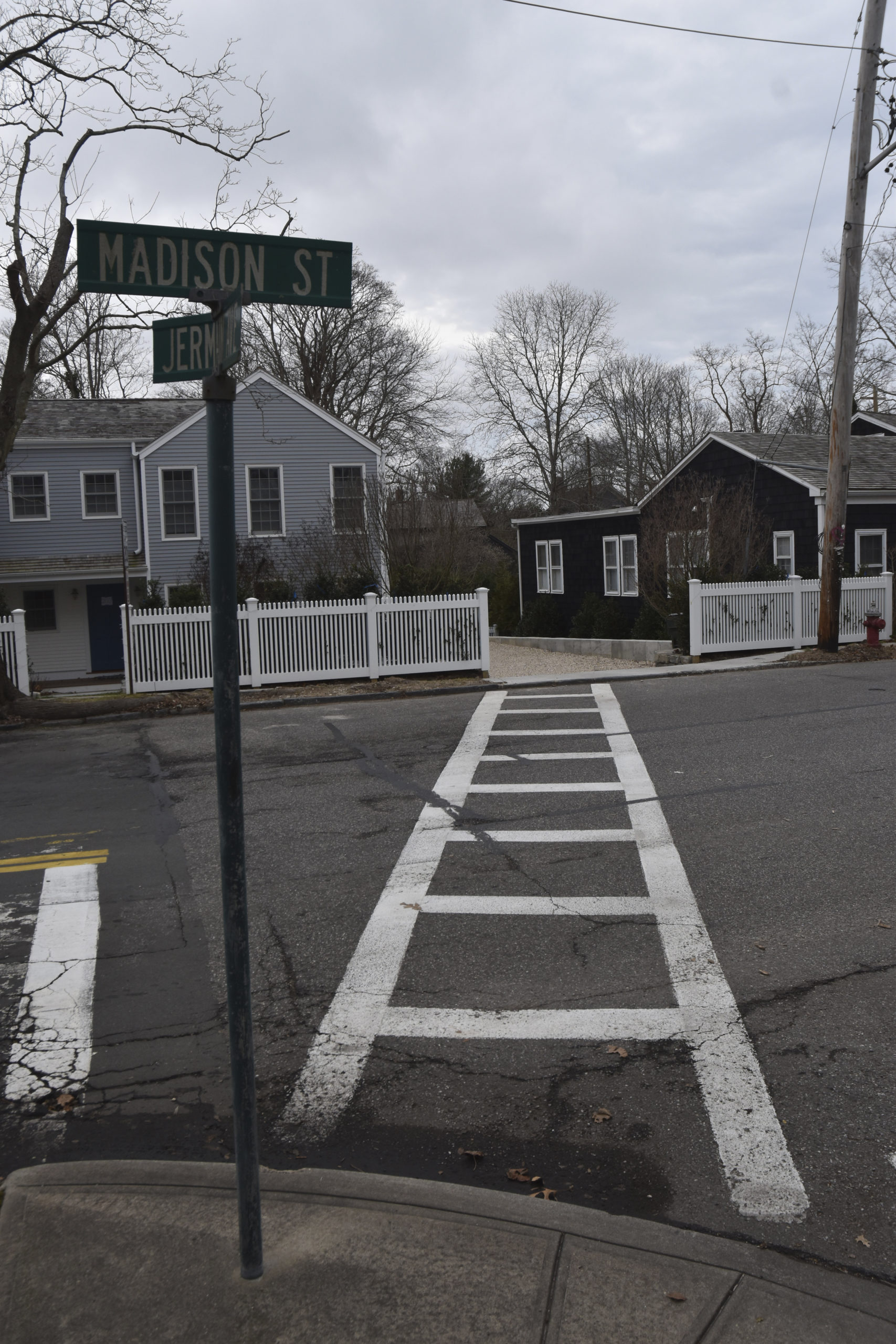 The Sag Harbor Village Board will hold a hearing next month to consider requiring the removal of this curb cut at 200 Madison Street which open into a crosswalk. STEPHEN J. KOTZ