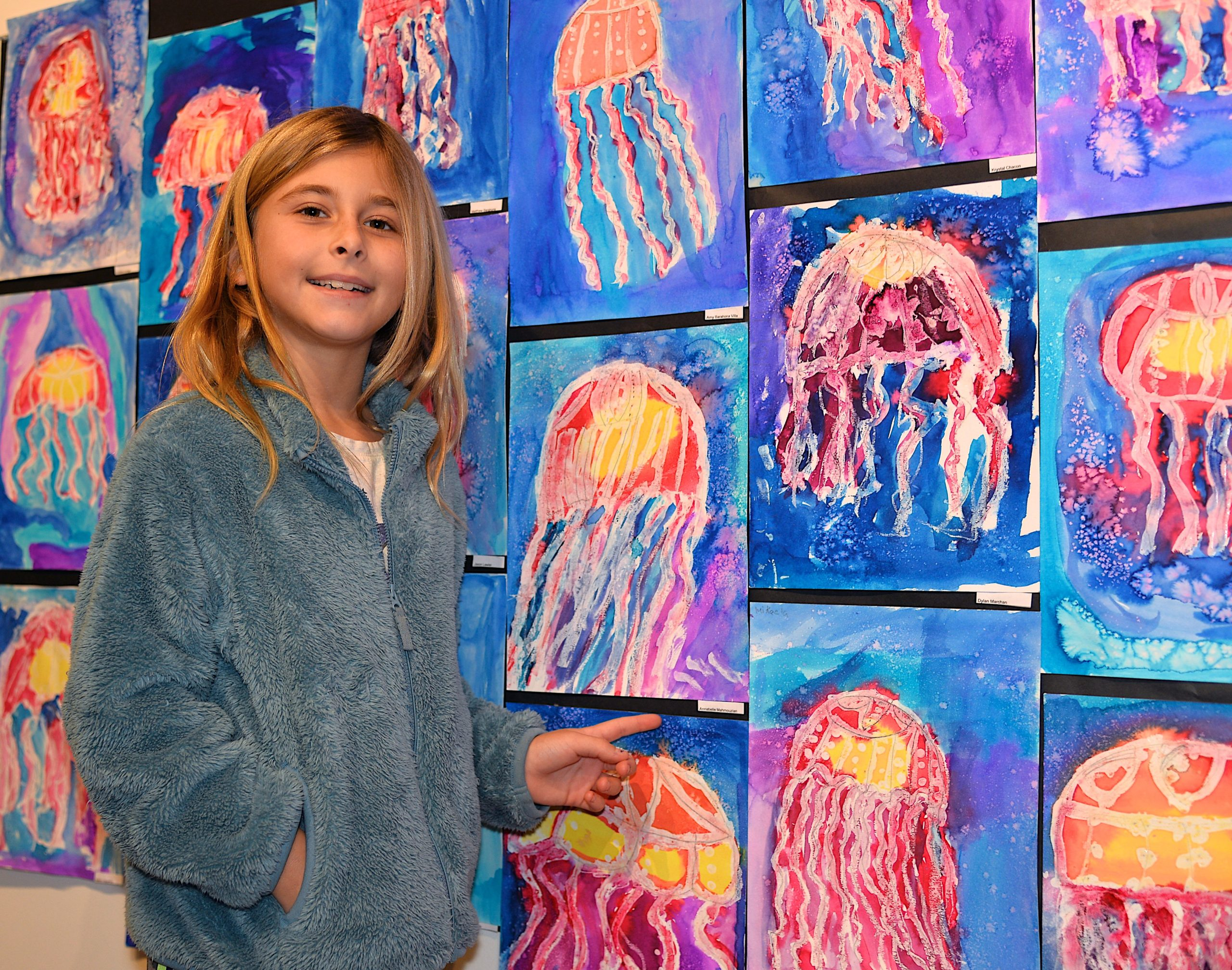 The Student Arts Festival opened at Guild Hall on Saturday with a reception. John Marshall Elementary School second-grader Annabelle Mahmouzian points to her work. KYRIL BROMLEY