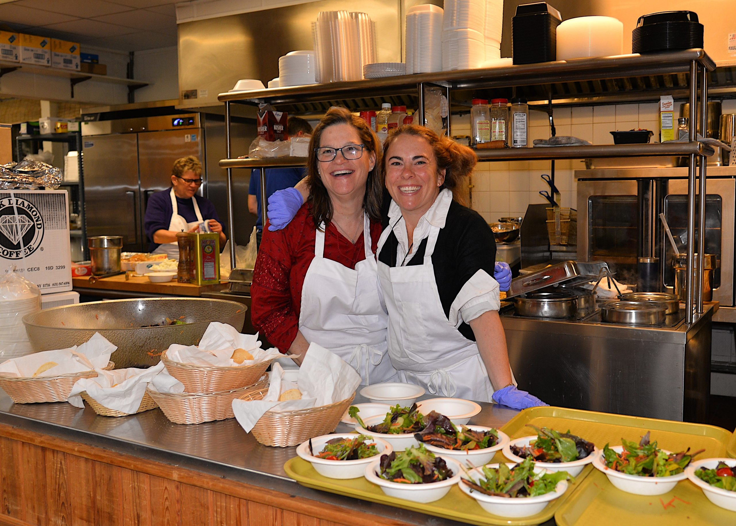 A pasta dinner fundraiser took place at the Montauk firehouse on Saturday to benefit the Robert R. Fisher scholarship fund. Regan Moloney and Shannon Coppola helped out. KYRIL BROMLEY