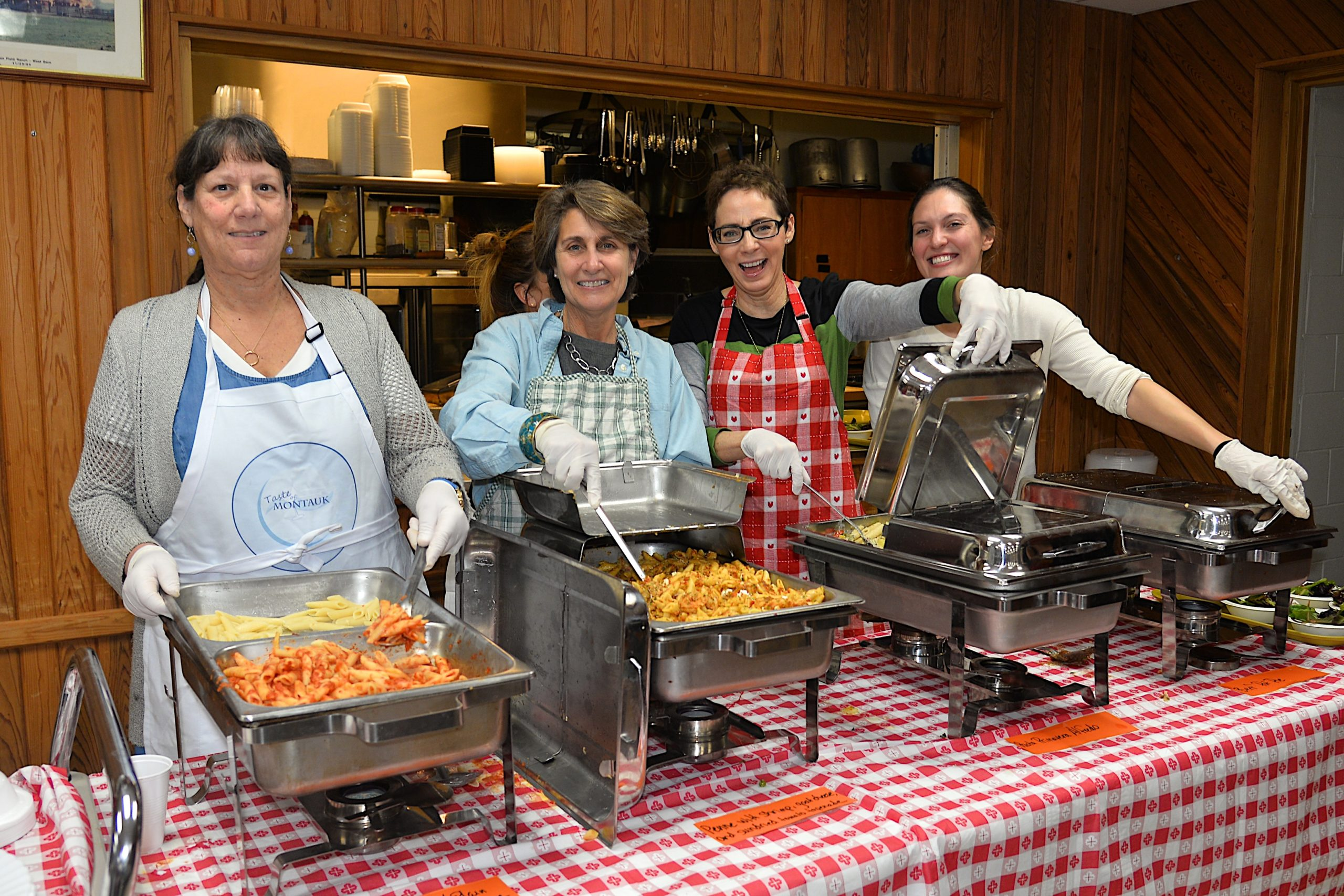 A pasta dinner fundraiser took place at the Montauk firehouse on Saturday to benefit the Robert R. Fisher scholarship fund. Dishing out the pasta were, from left, Donna DiPaolo, Judith Pfister, Patricia Byrne and Nicole George. KYRIL BROMLEY