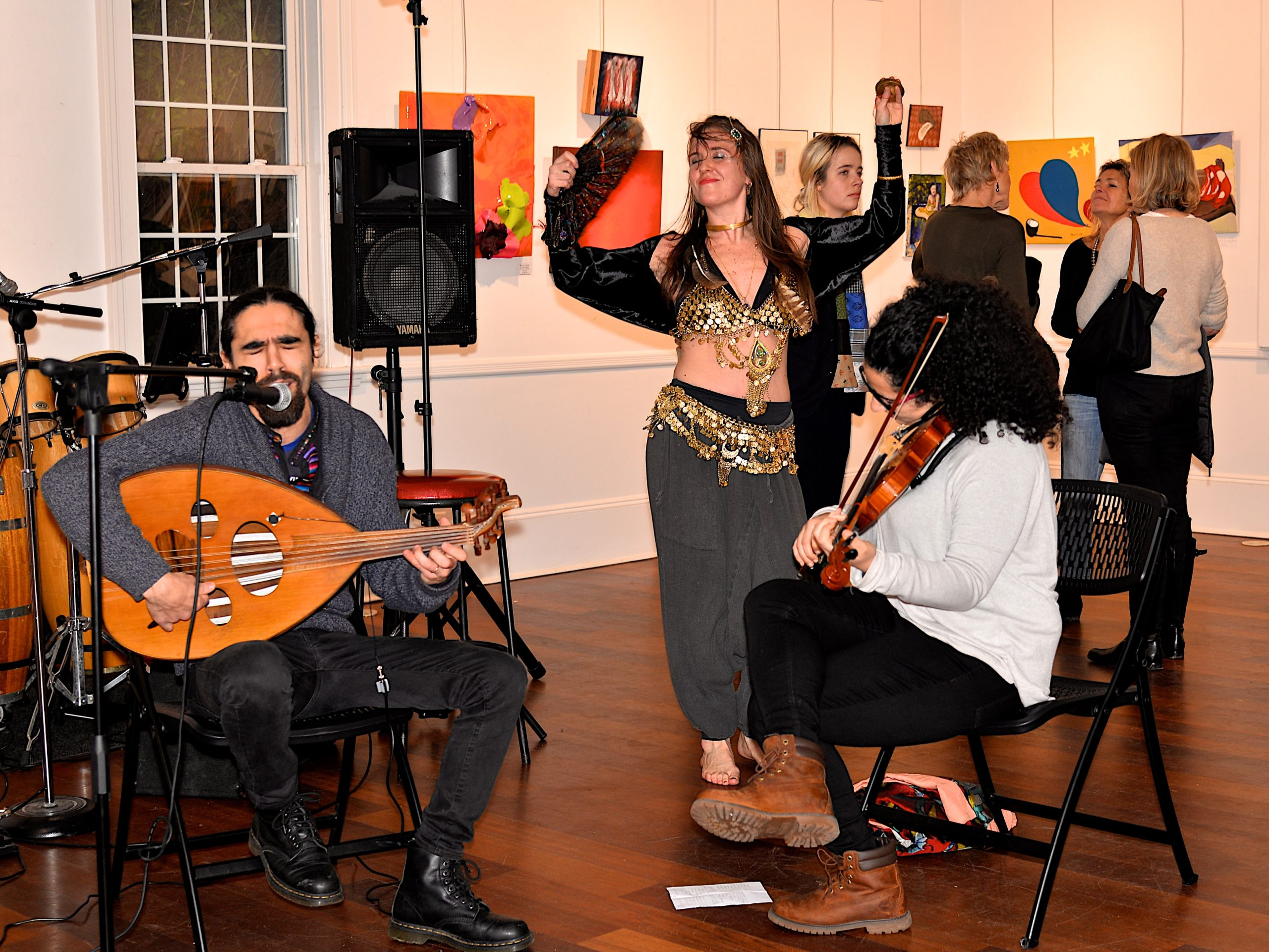 The Love And Passion art show, curated by Karyn Mannix, opened at Ashawagh Hall last weekend and featured art work, music, dancing and poetry. Molly Moonbeam dancing while the Al Hawili Band plays. KYRIL BROMLEY