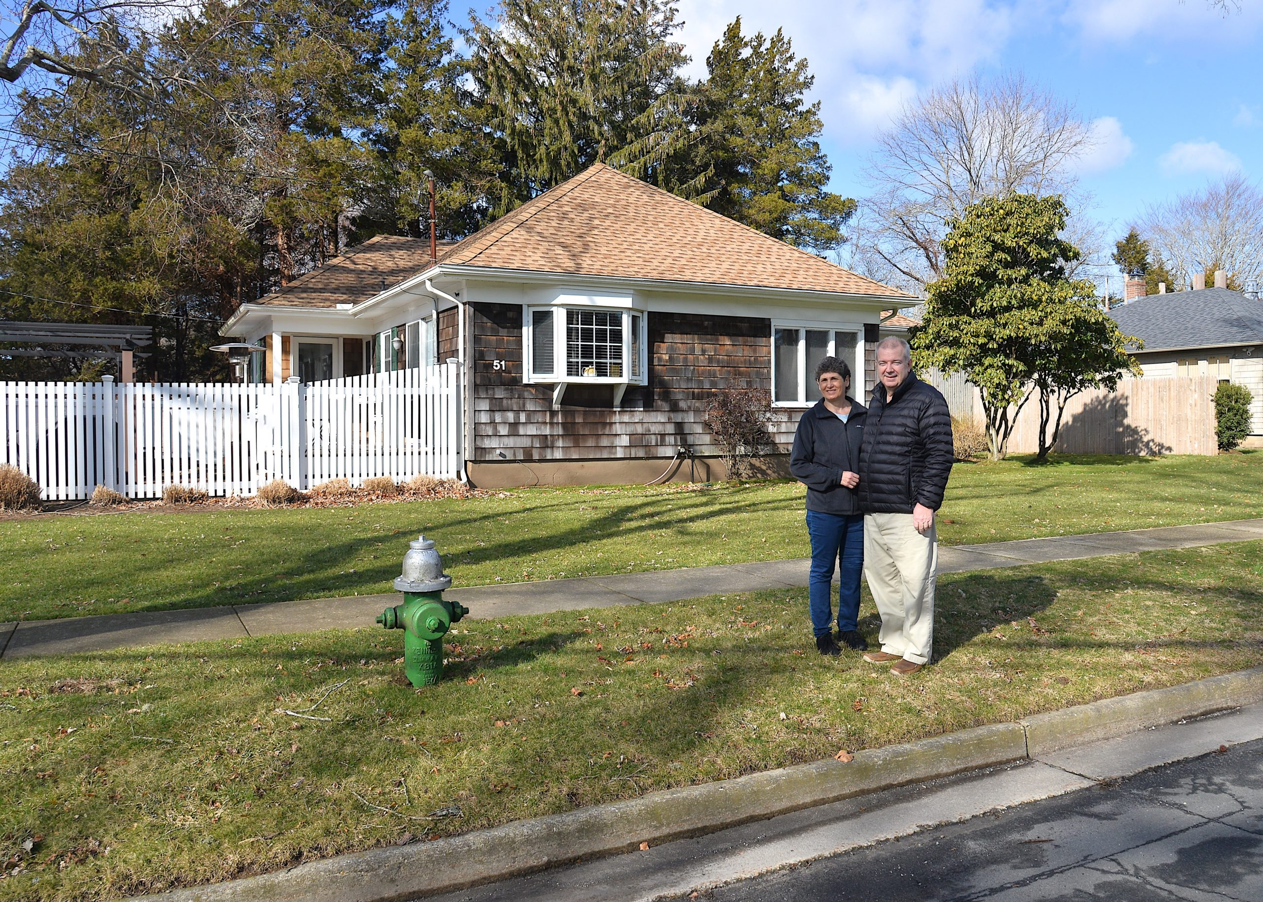 Yvonne and Daniel Ujvari stand where the riser pole would go in front of their home.  KYRIL BROMLEY