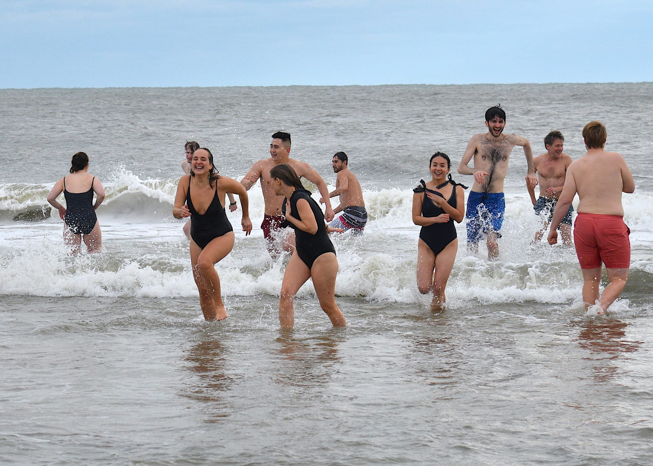 Dozens of brave souls gathered on New Year's Day for the annual polar plunge at a Wainscott beach, organized by the Seafood Shop. This year's event raised money for the Sag Harbor food pantry. KYRIL BROMLEY