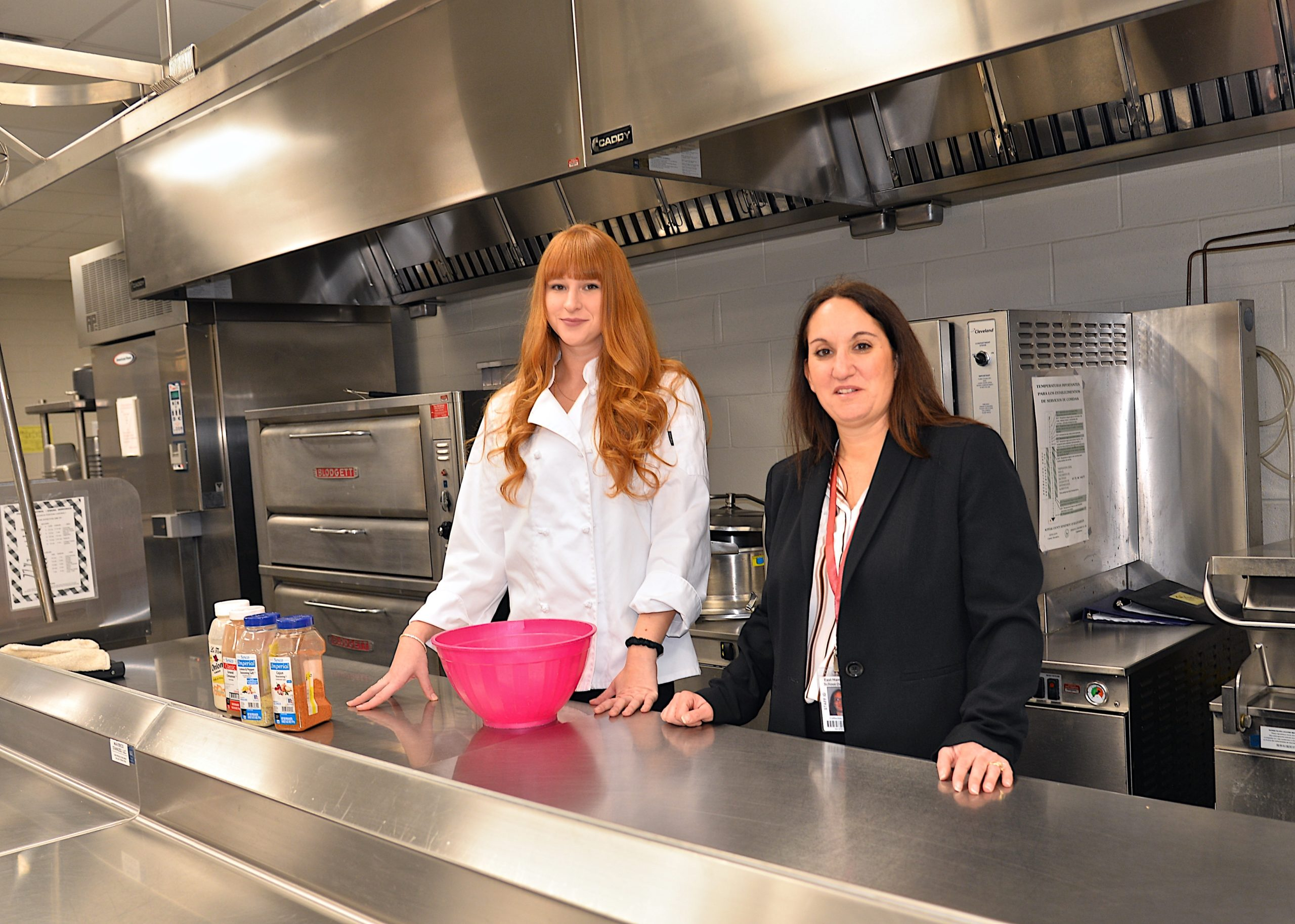 East Hampton culinary arts teacher Kelly Doyle, left, and business teacher and Career and Technical Education coordinator Catherine Tyrie in the East Hampton High School cafeteria kitchen. Kyril Bromley