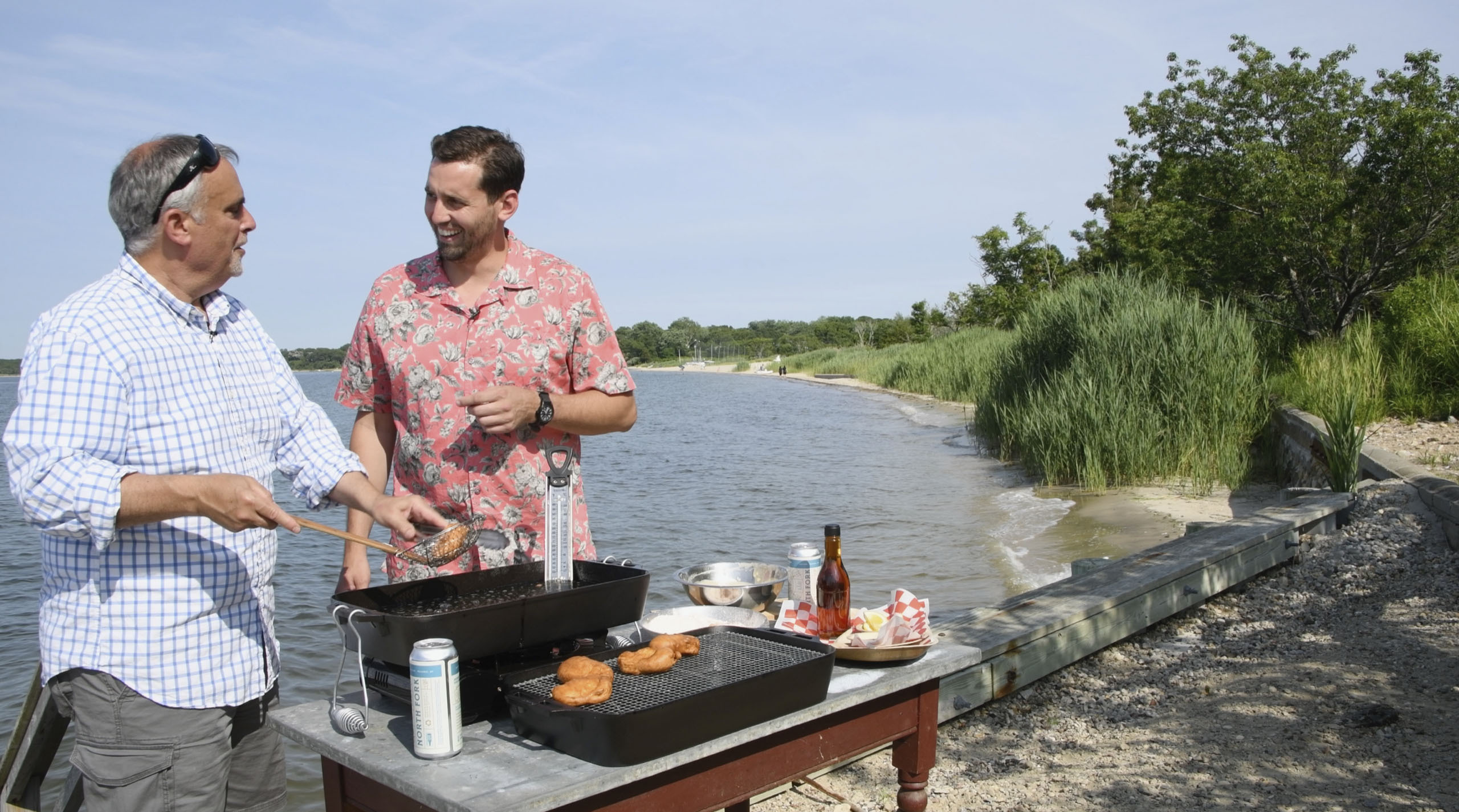 Chef George Hirsch and Alex Goetzfried cooking waterside at Cormaria in Sag Harbor.