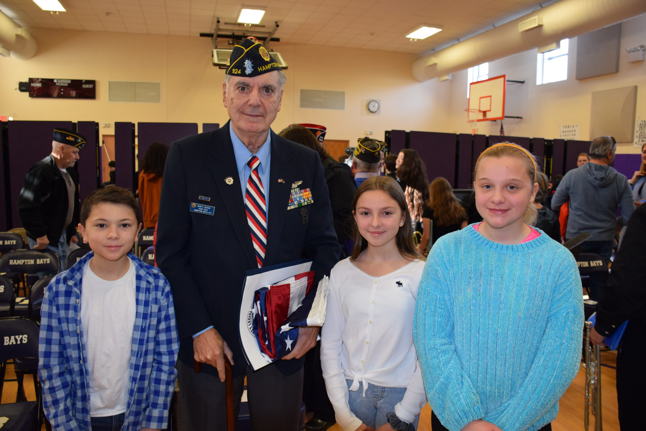 Hampton Bays students, including  Nico Carone, Keira Nappi and Adriana Tapfer, honored U.S Air Force veteran John Constantine Dekas during a flag ceremony on January 24.