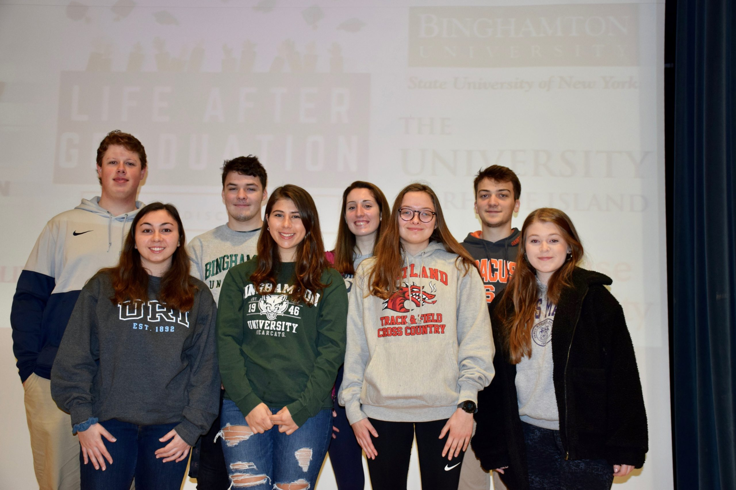 Eighth-graders at Hampton Bays Middle School learned about a variety of colleges from visiting Hampton Bays High School alumni during the middle school's 12th annual College Awareness Day. Back row, left to right, Sean Noonan (Penn State University), Thomas O'Connell (Binghamton University), Bridget Hughes (University of South Carolina) and Jared Strecker (Syracuse University), front, Sarah Fassino (University of Rhode Island), Christina Coulton (Binghamton University) Maryrose O'Connell (SUNY Cortland), and Meghan Long (James Madison University).