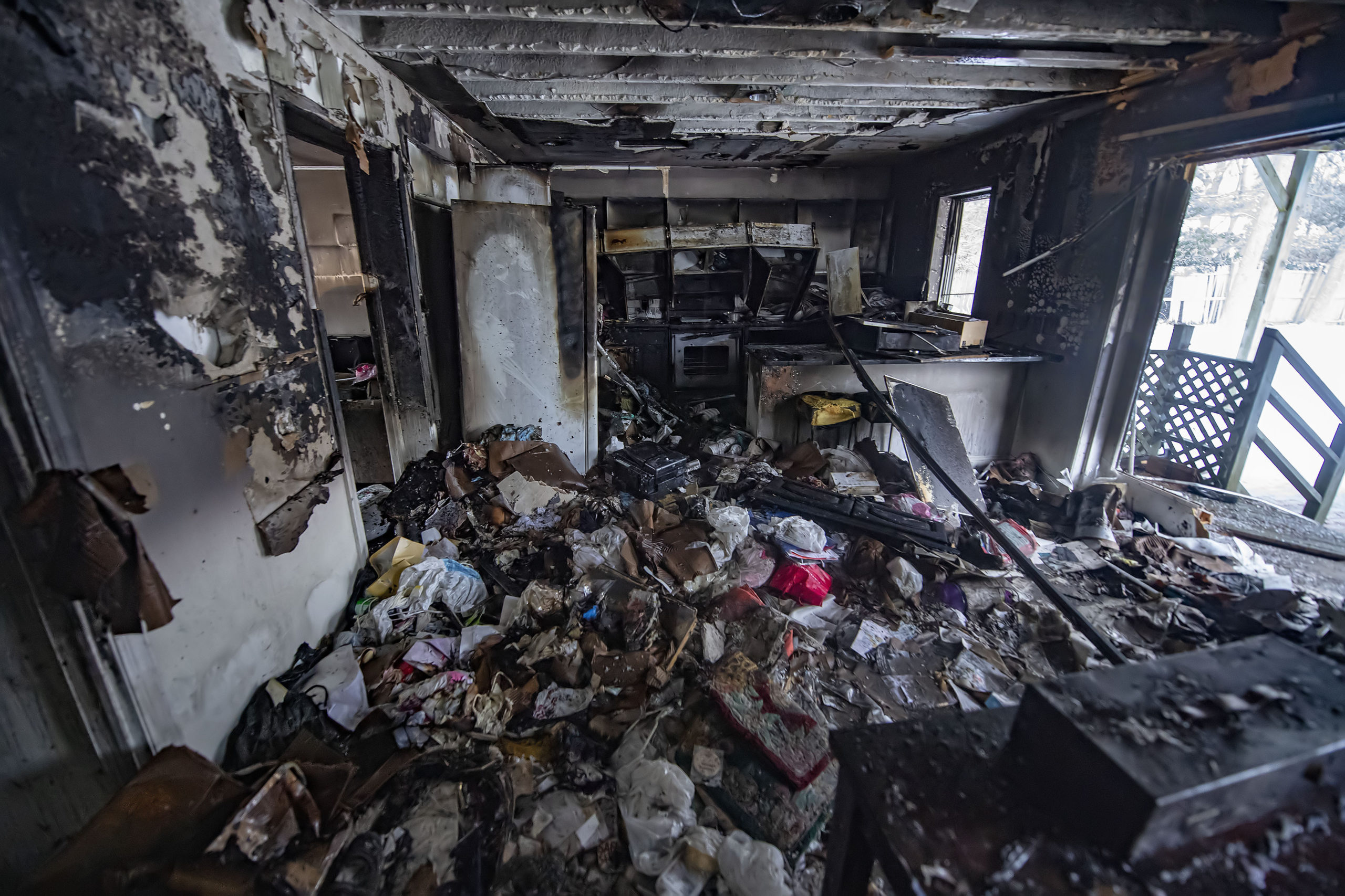 A view inside the kitchen area inside the residence following the working house fire at 38 Cove Hollow Road in East Hampton on Saturday.  MICHAEL HELLER