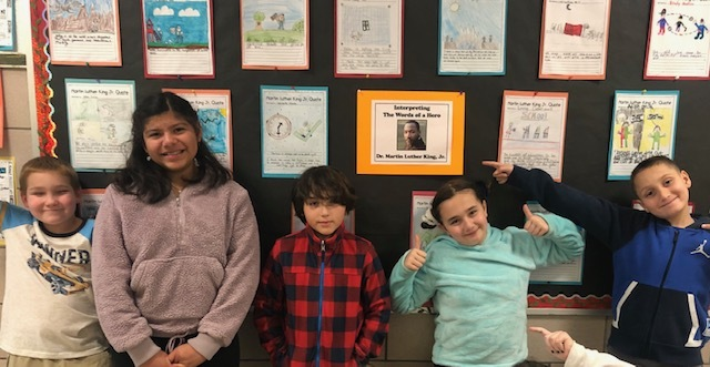Cary Wyllie's fifth-graders, from left, Liam O'Connor ,Kayden Mulvane, Londhen Escobar, Joaquin Jimenez and Nico Cortina, at East Quogue Elementary School created artistic interpretations of famous quotes by Martin Luther King Jr.