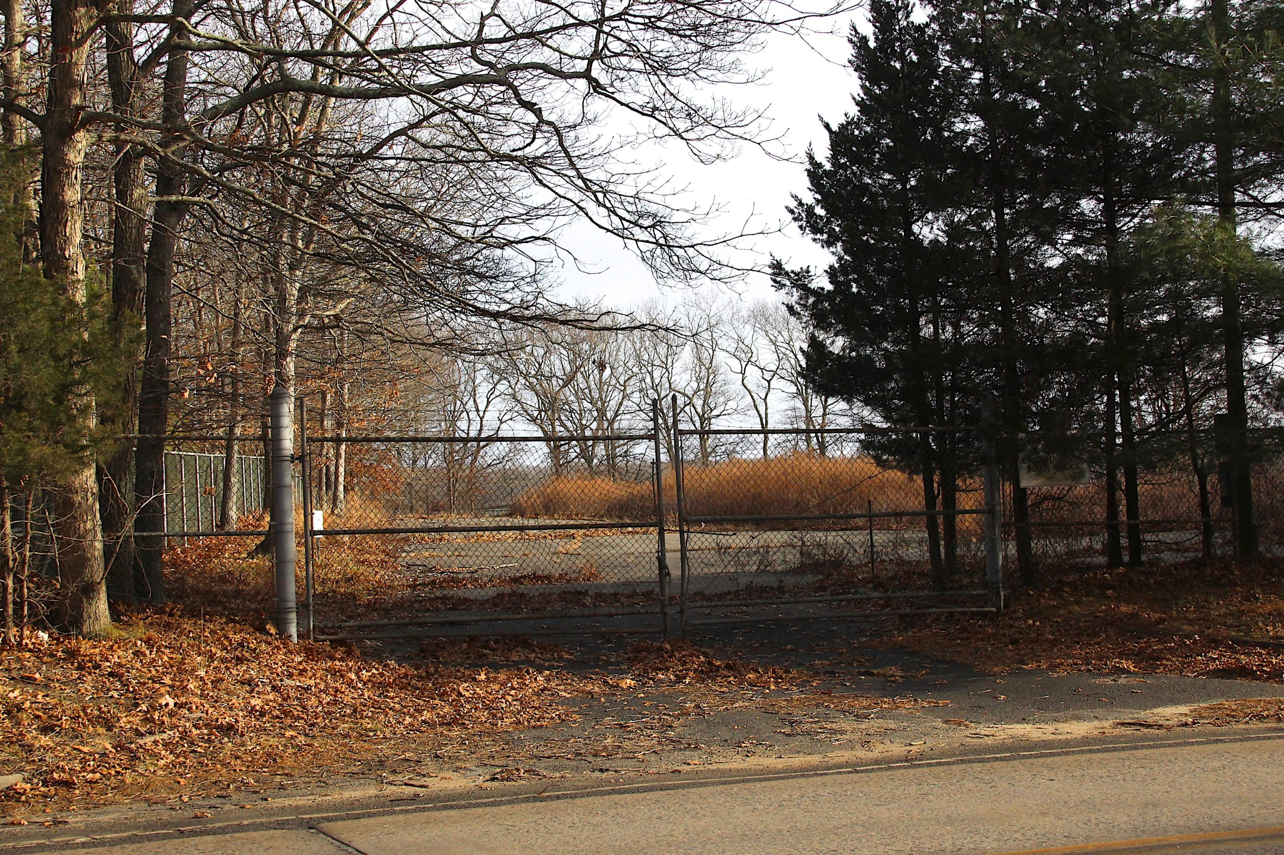 Two years after voters approved the purchase, the East Hampton School District on Monday closed on the purchase of the former East Hampton Town scavenger waste treatement center. The property will be converted into a bus depot and classroom for a new mechanics vocational program.KYRIL BROMLEY