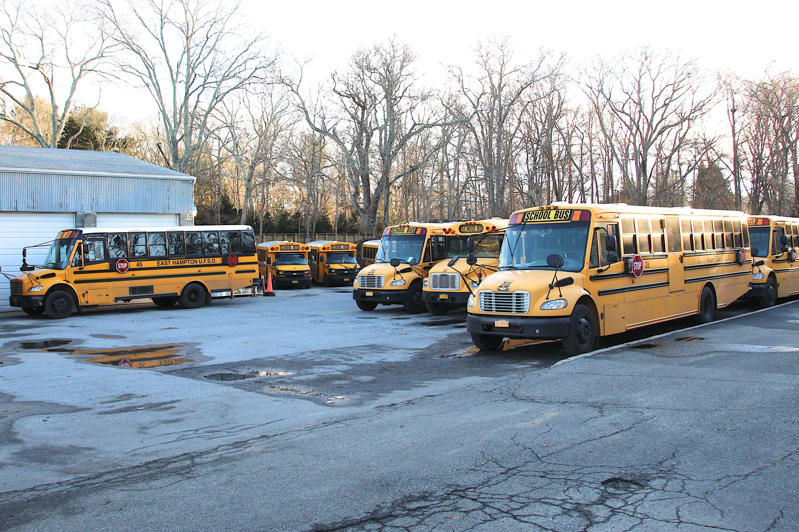 The East Hampton School District has been leasing the former Schaefer Bus Company property on Route 114 to store its bus fleet. The district will be moving the operation to property it approached next to the East Hampton Town Recycling Center on Springs-Fireplace Road. KYRIL BROMLEY