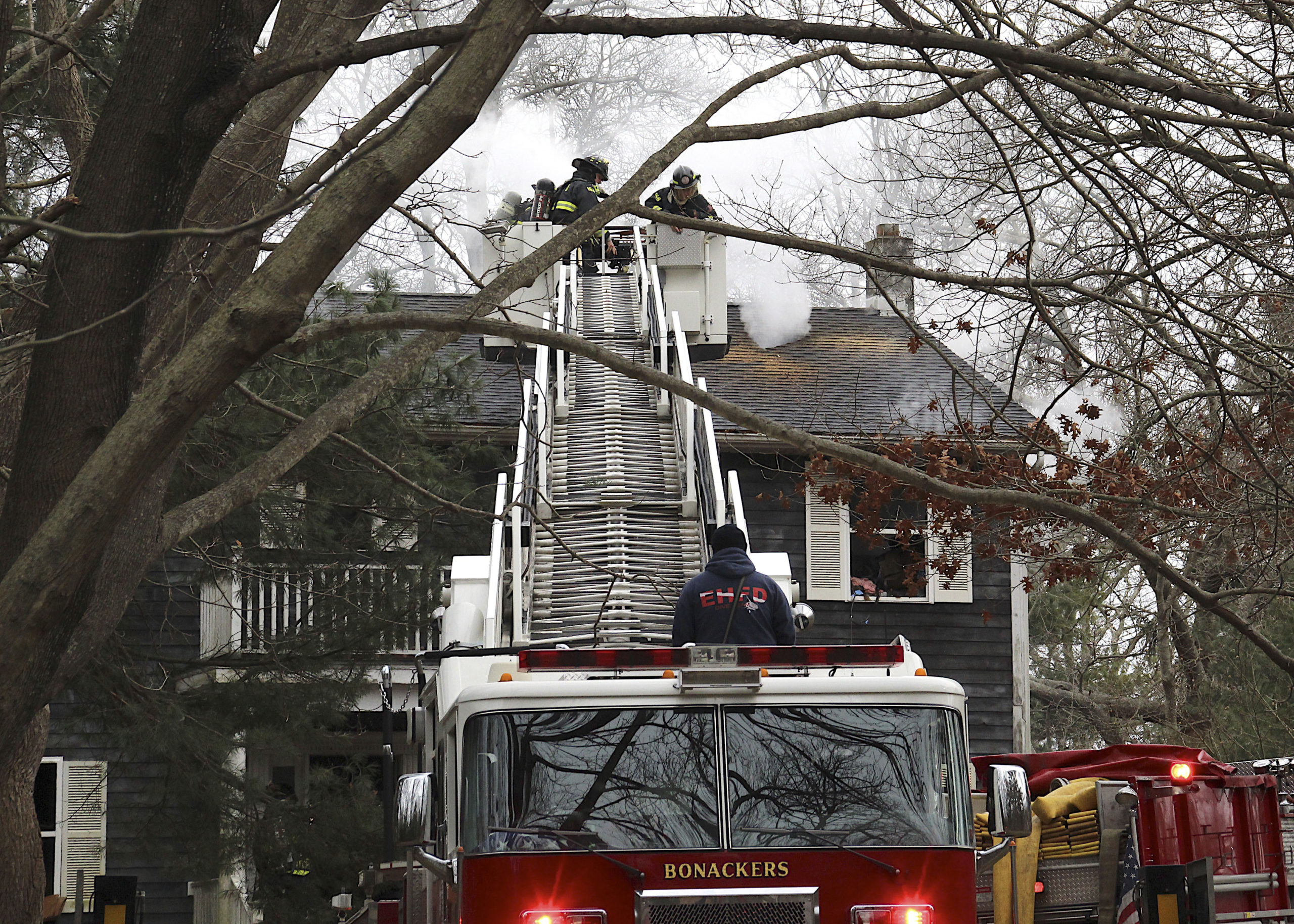 Firefighters at 38 Cove Hollow Road in East Hampton on Saturday.         KYRIL BROMLEY