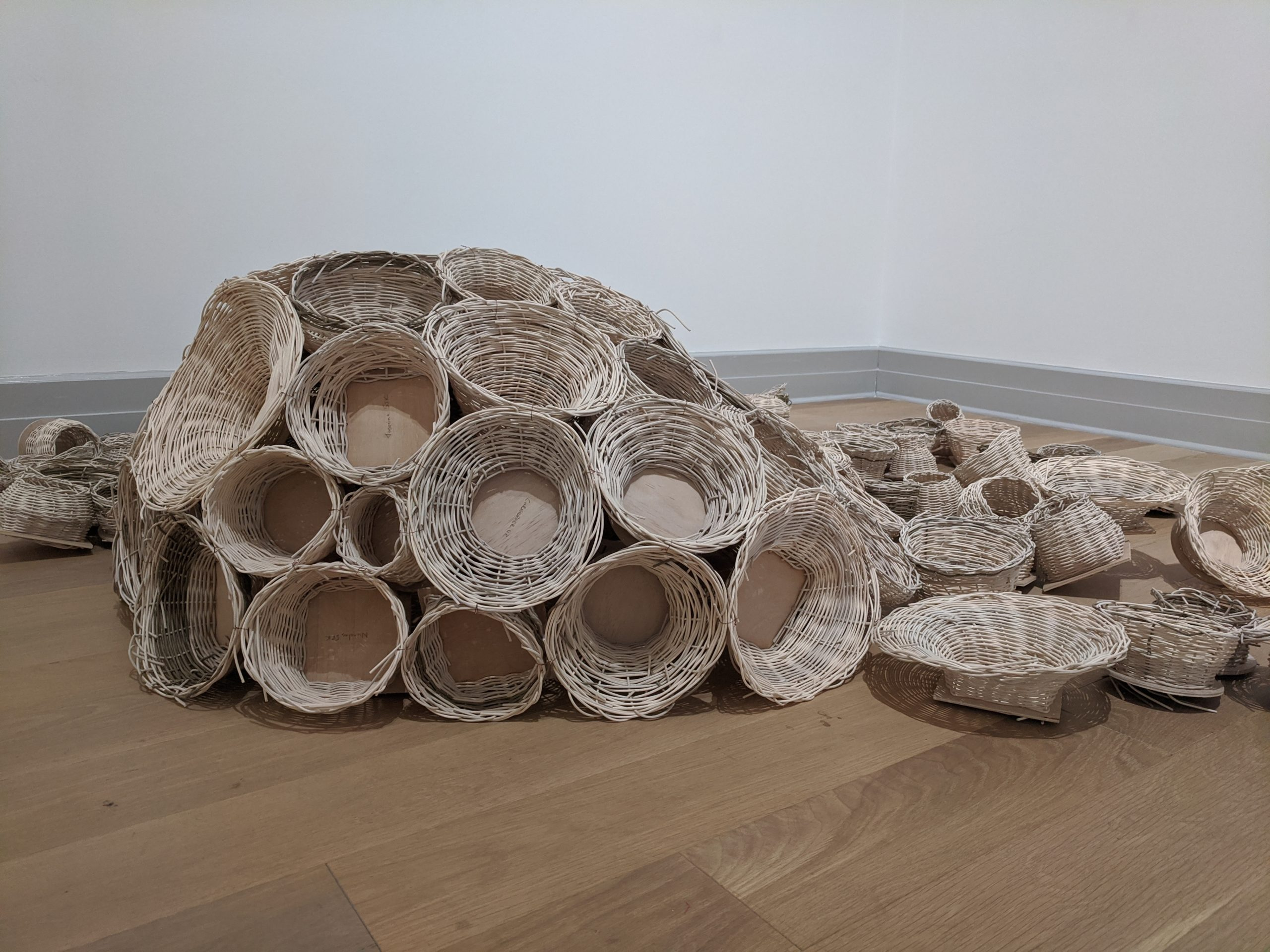 The 150 fourth and fifth graders in Gary Osborne's art classes at Sag Harbor Elementary School used the theme of water to hand-weave baskets from reeds soaked in water. The baskets are assembled in the shape of an octopus in the galleries at Guild Hall.