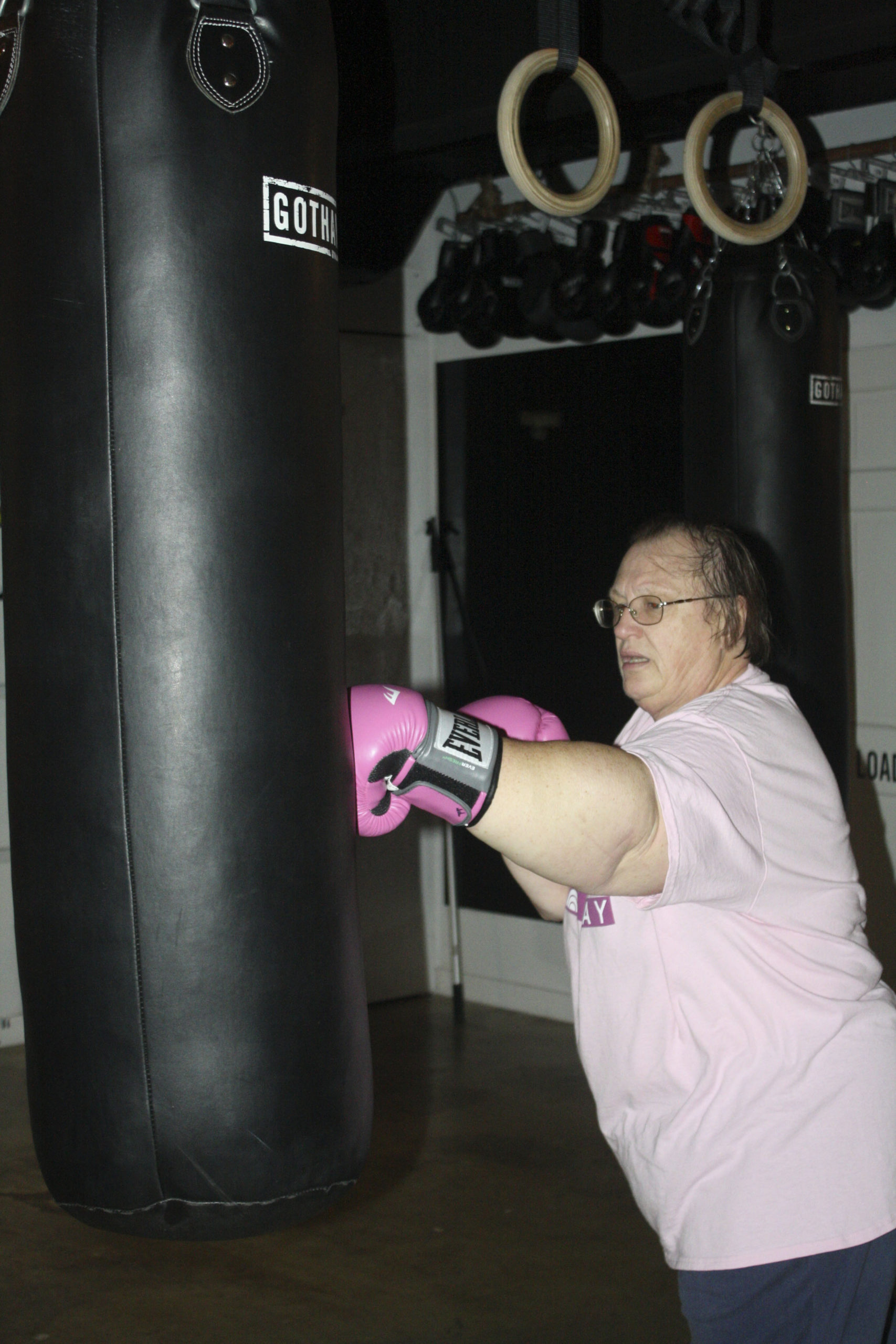 A survivor works out at the gym.  CAILIN RILEY