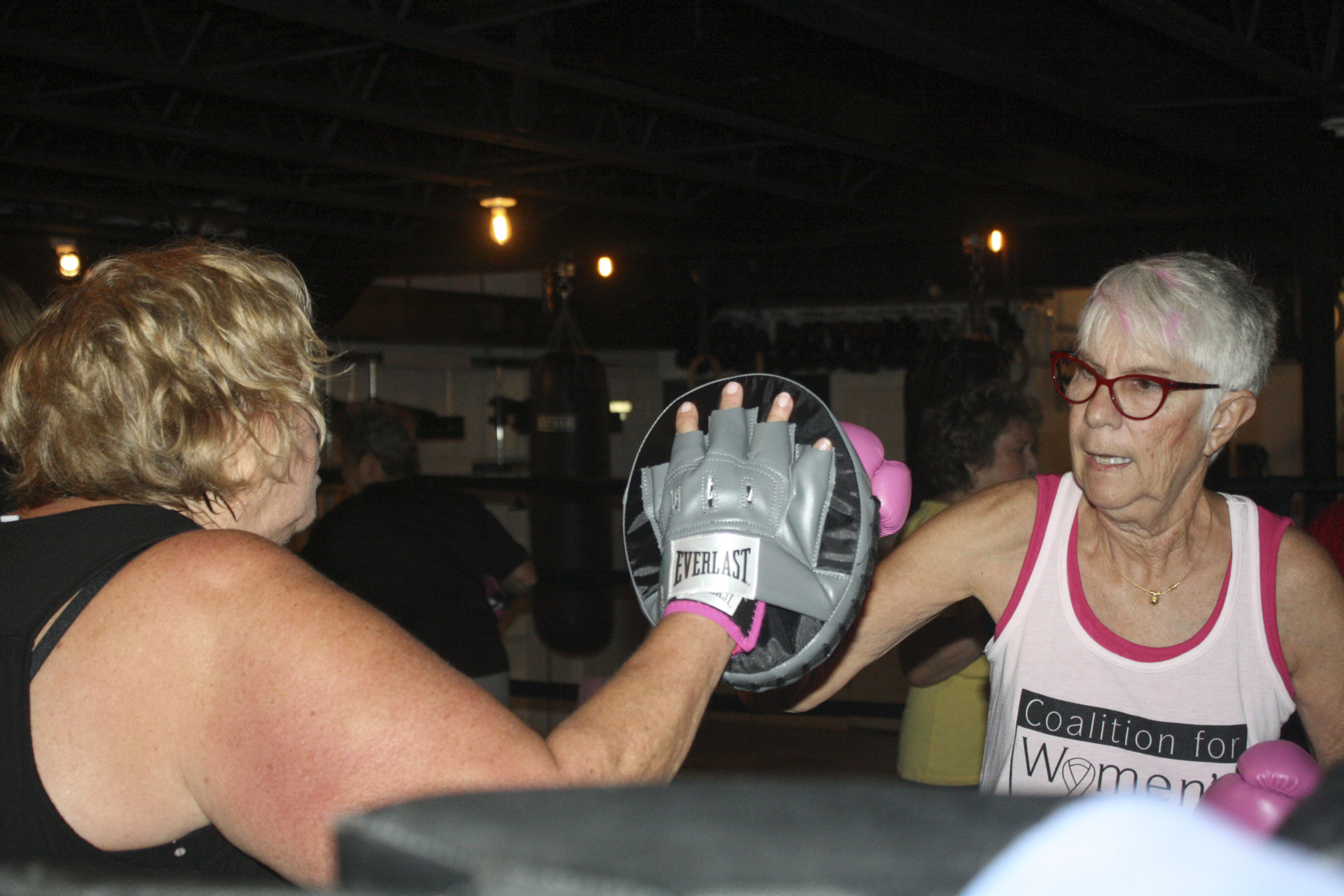 Fight Mode, founder Susie Roden, left, in the ring with Vicki Durand. CALIN RILEY