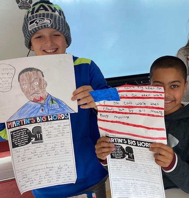 "Liam Brand and Nic Simone show off the projects they created to celebrate Martin Luther King Jr. Day . They researched his words and were guided by ""Only love drives out hate."""