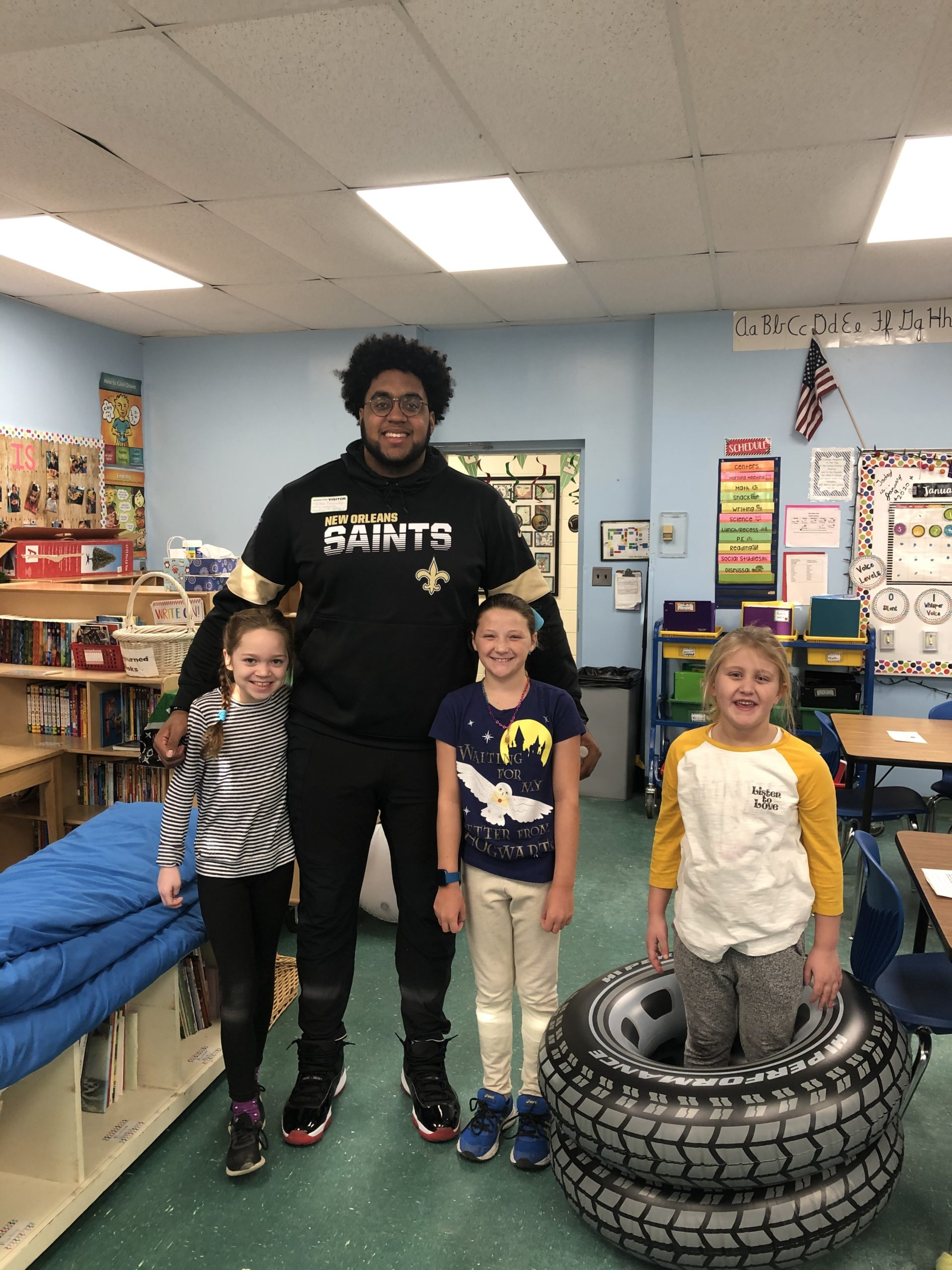 New Orleans Saints offensive lineman Ethan Greenidge visited fourth-graders at Springs School recently. During his visit, he talked about the importance of teamwork and dedication. Students also got to practice their interviewing skills. He is the brother of a teaching assistant.