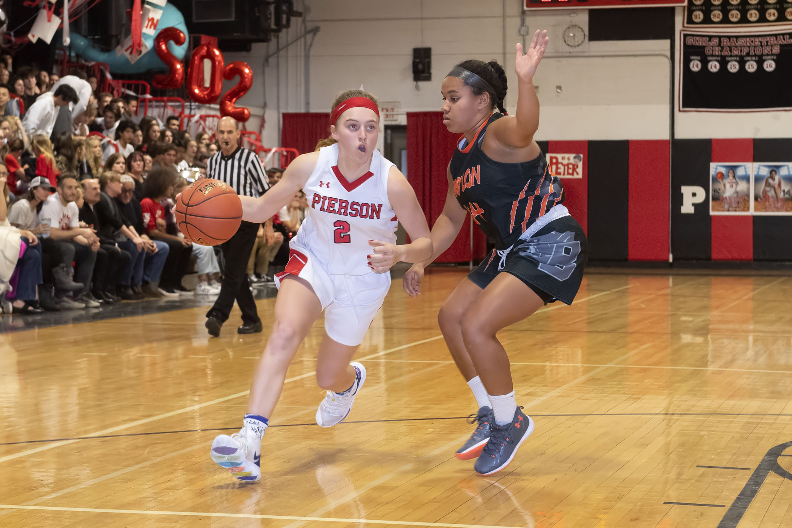 Pierson's Grace Perello drives on Babylon's Emma Ward.