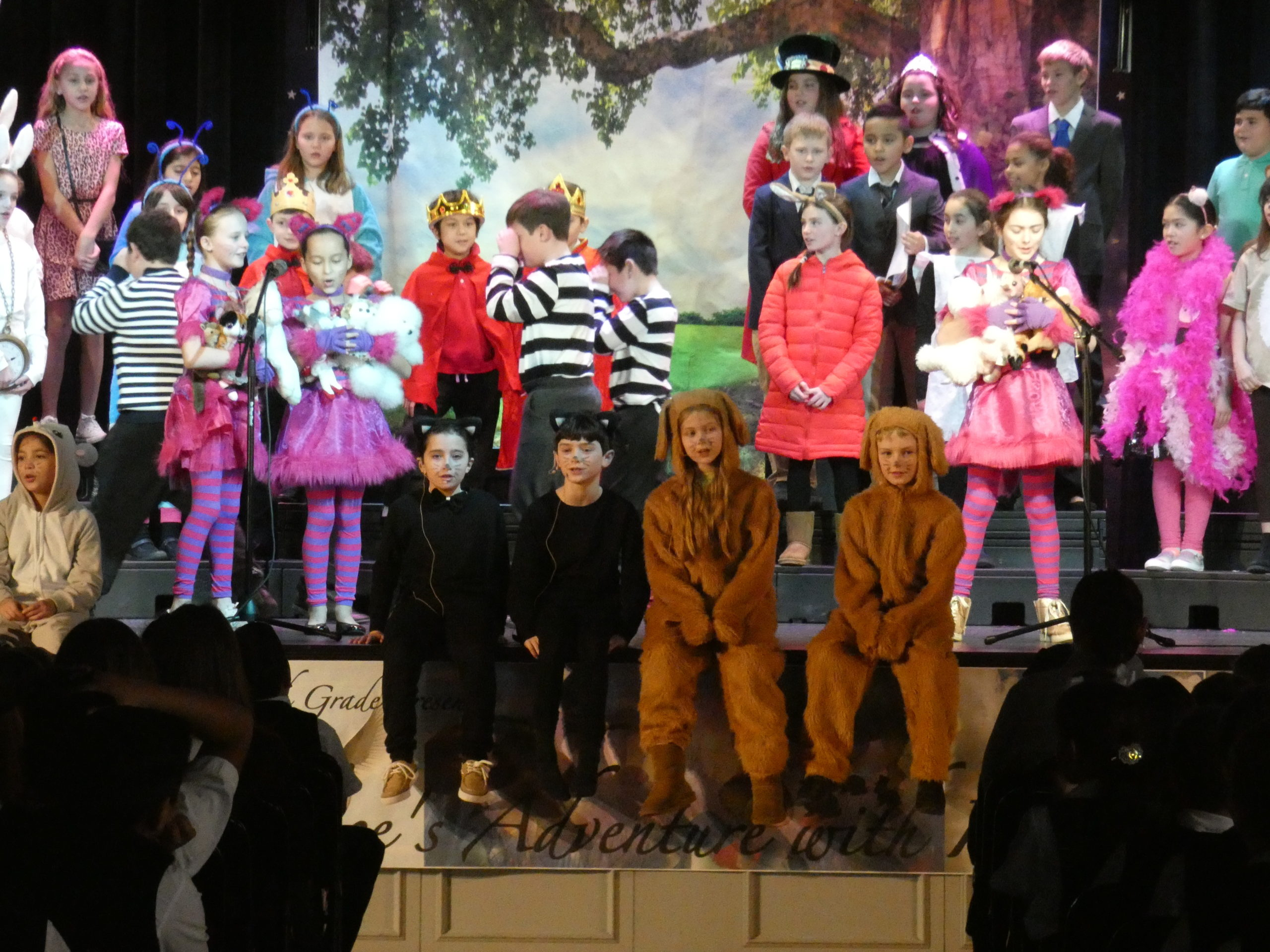 "Fourth-graders at Our Lady of the Hamptons School   presented a special assembly ""Alice's Adventures with Idioms,"" a play based on English grammar in song and dance."
